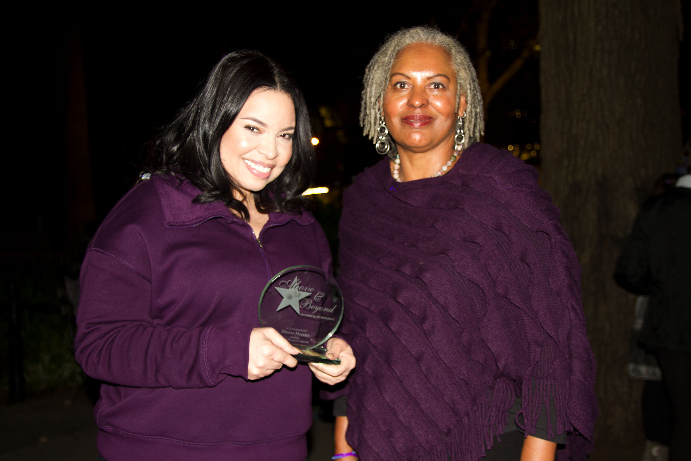 Executive Director Gwen Wright presents Ilianexy Morales with the 2017 Full Circle Award