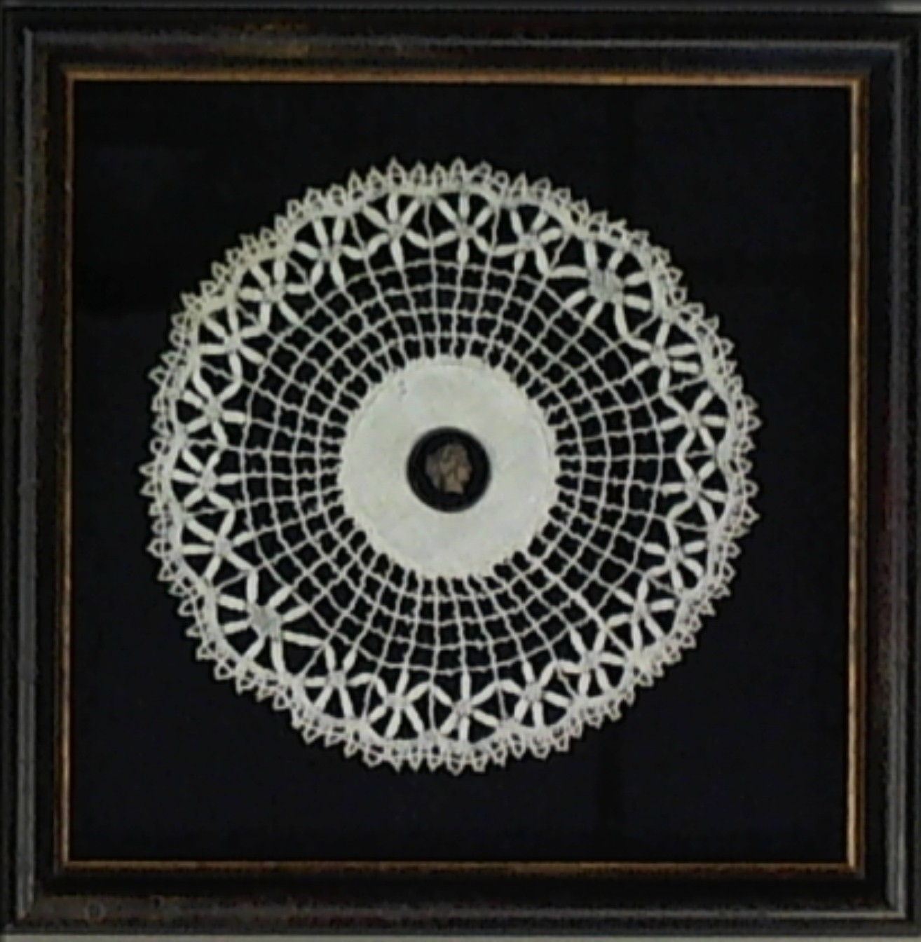 framed crochet doily