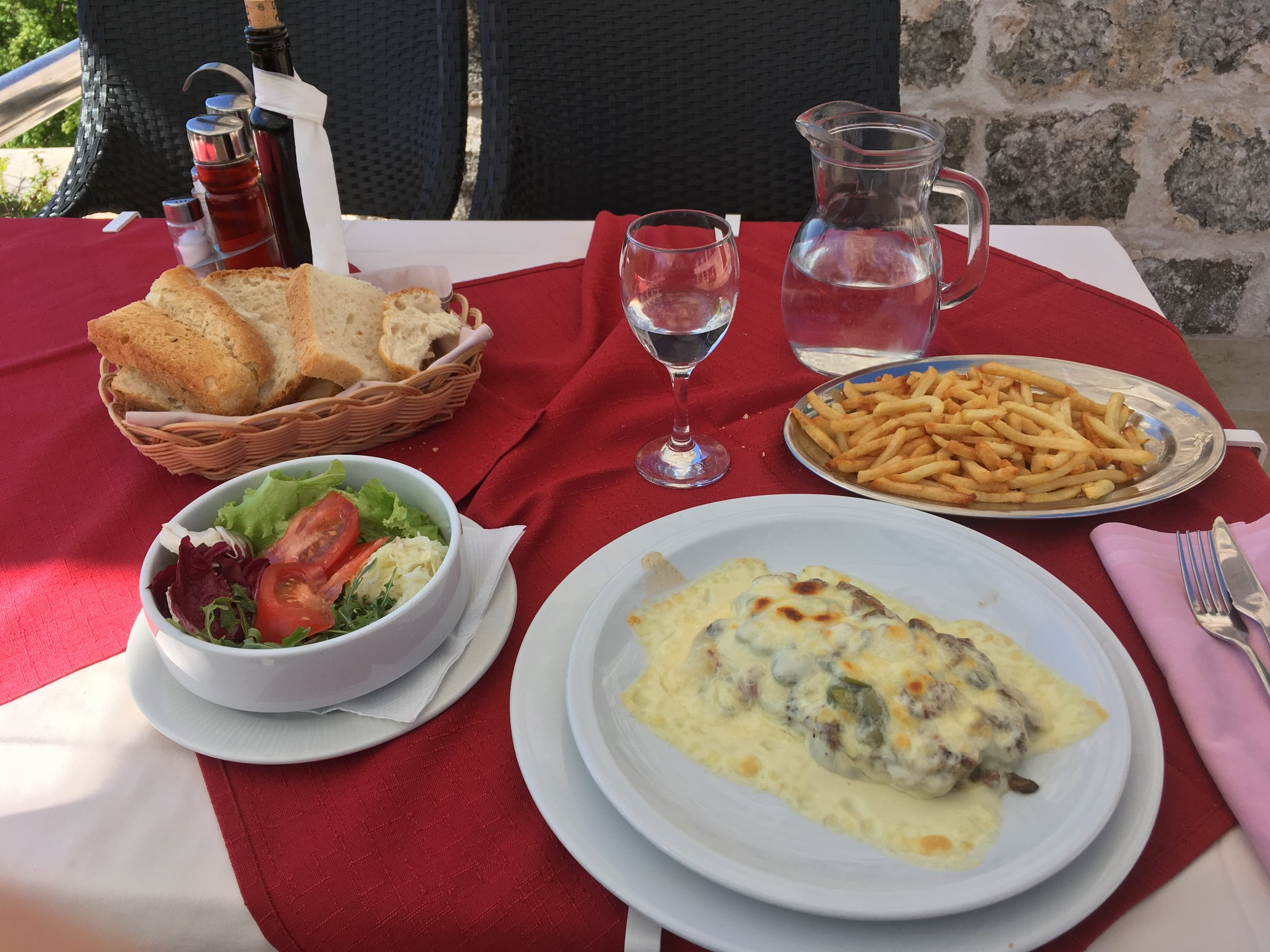 A generous portion of minced lamb covered in cheese obtained on the island of Brač.