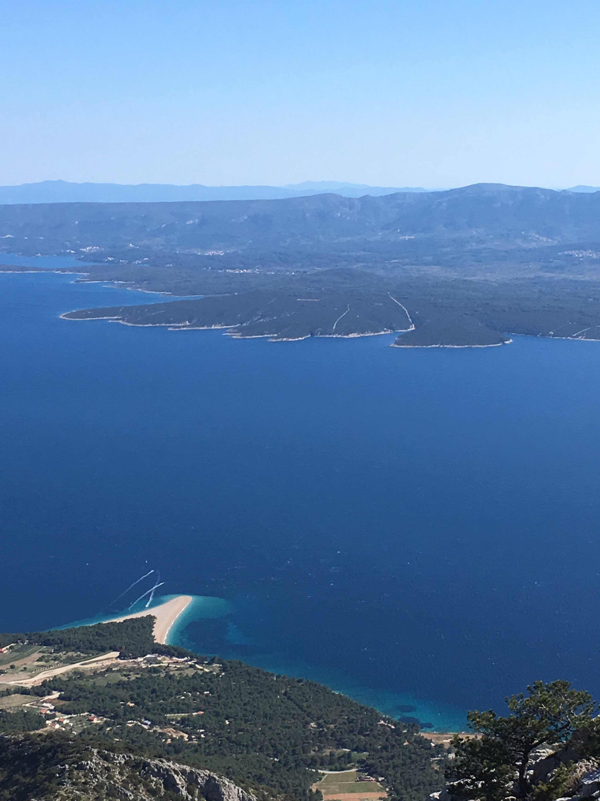 Seen from the top of Vidova Gora, the highest point in the Adriatic islands, you can see the funny little pointy beach of Rat
