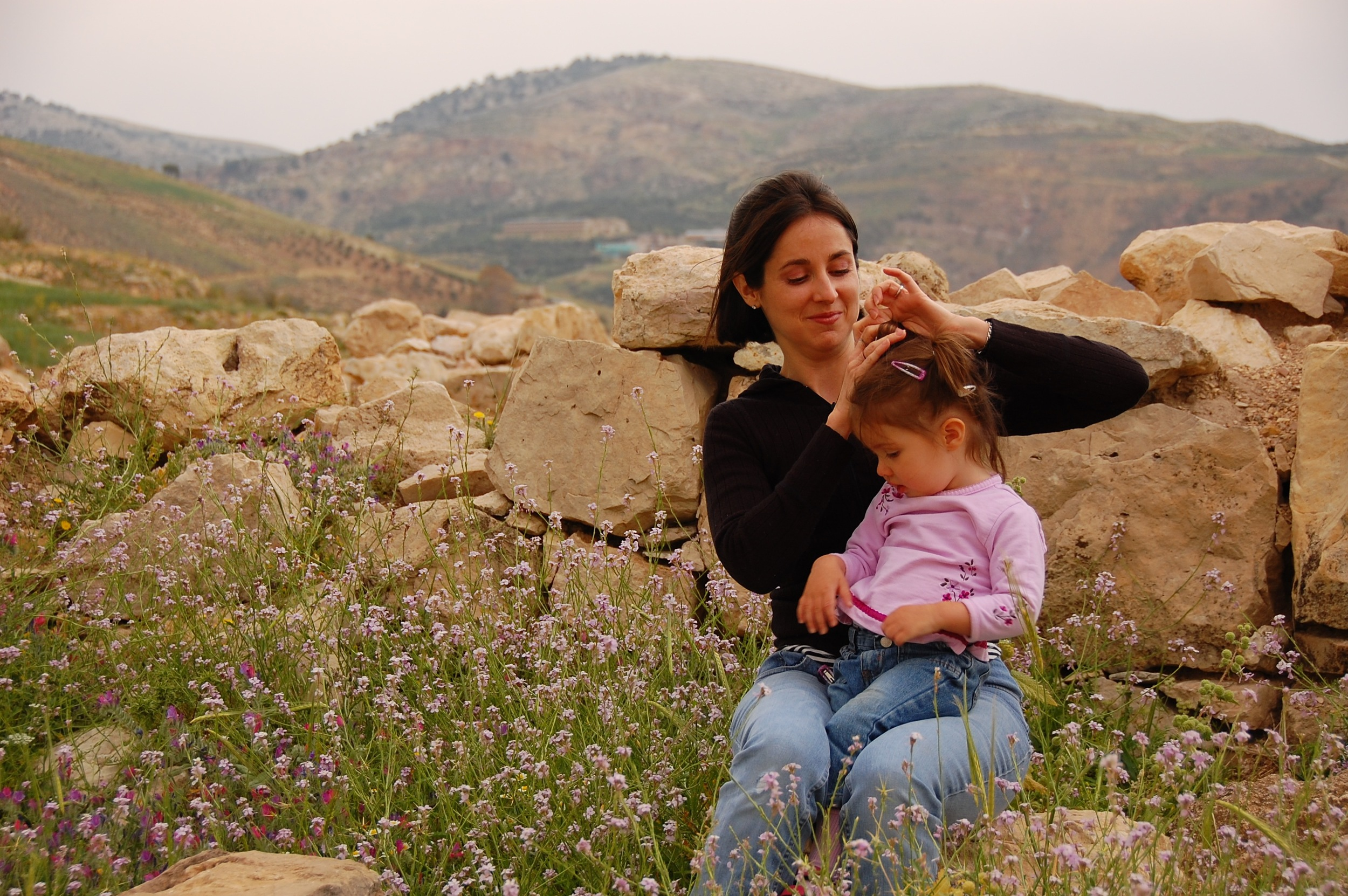 That looks really hard fixing that kid's hair, and I would like to help, but later you will thank me for backing up further to get more wildflowers in the shot. (Wadi al-Sir, Jordan; Apr 2009)