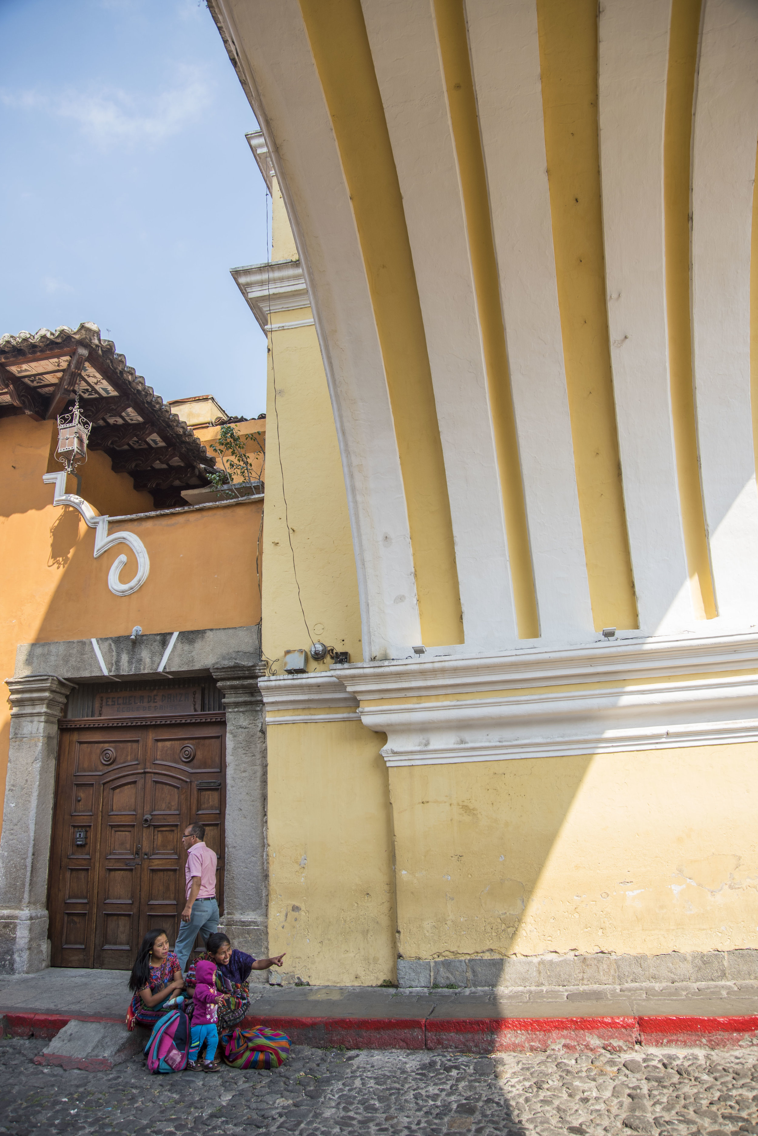 I was bored of pictures of Antigua's iconic arch, so here's what was going on under the arch. Pointing is rude, lady! (Antigua, Guatemala; Feb 2017)