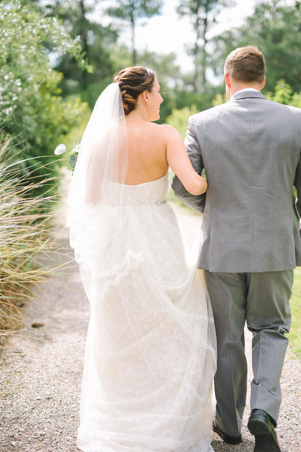 meagan-and-brenden-rach-loves-troy-photography-ivory-and-beau-bridal-boutqiue-ti-adora-wedding-dress-gold-lace-wedding-dress-savannah-wedding-planner-savannah-weddings-oldfield-plantation-wedding-savannah-florist-21.jpg