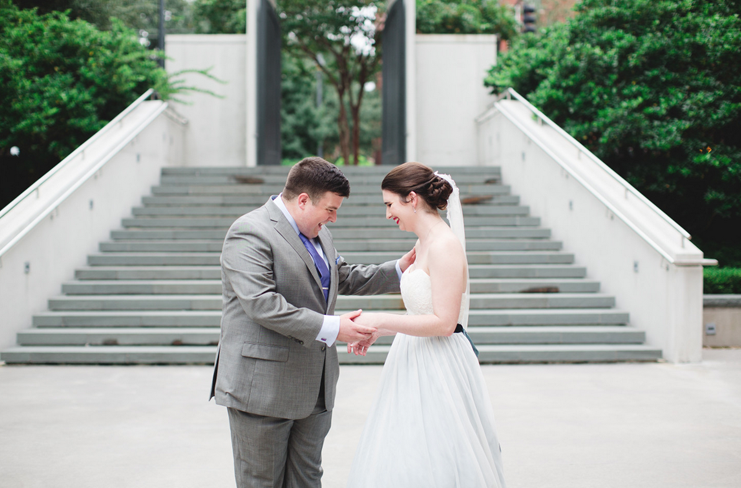 first-look-bride-and-groom-ivory-and-beau-savannah-wedding-planner-savannah-bridal-boutique-blue-wedding-dress-izzy-hudgins-tiffany-and-sean-roundhouse-railroad-museum-wedding.png