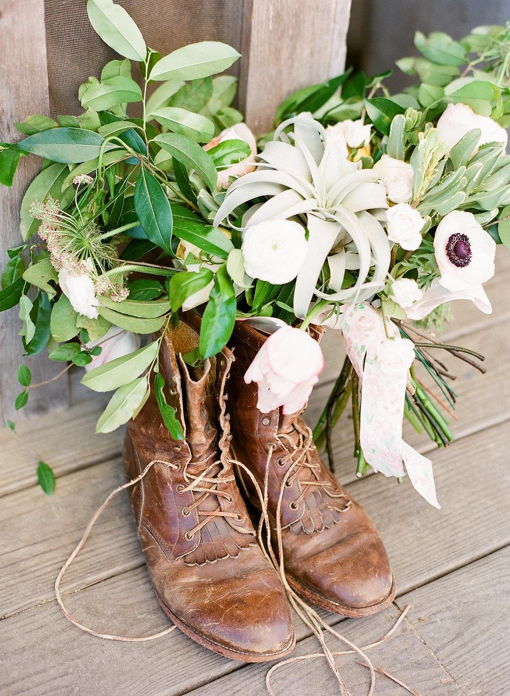 the-wyld-savannah-wedding-venue-ivory-and-beau-savannah-wedding-planner-savannah-event-designer-savannah-wedding-florist-bridal-bouquet-with-airplants-rustic-outdoor-dock-bar-wedding.jpg