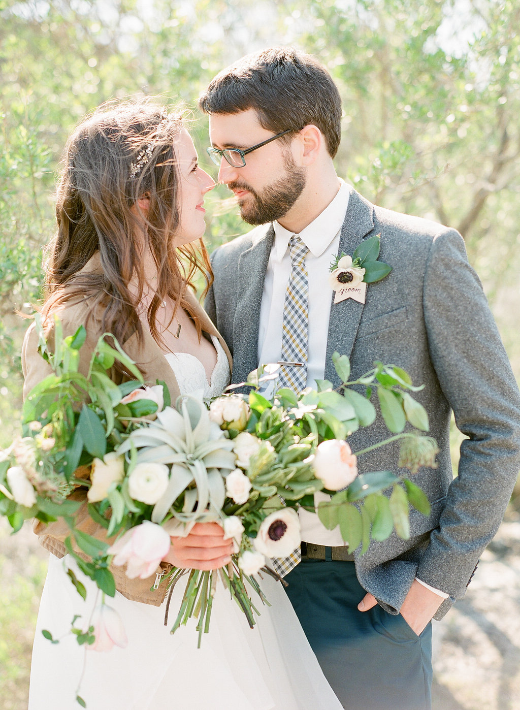 sarah-seven-worthington-ivory-and-beau-savannah-wedding-planner-savannah-bridal-boutique-savannah-wedding-dresses-organza-flowy-wedding-dress-savannah-wedding-florist-bouquet.jpg