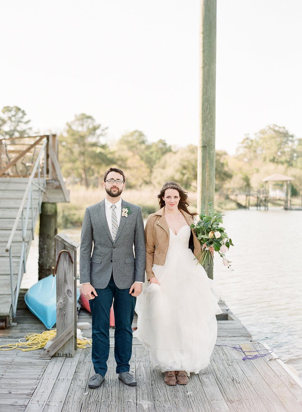 the-wyld-ivory-and-beau-sarah-seven-worthington-wedding-dress-savannah-bridal-boutique-savannah-wedding-dresses-leather-jacket-the-wyld-dock-bar-wedding.jpg