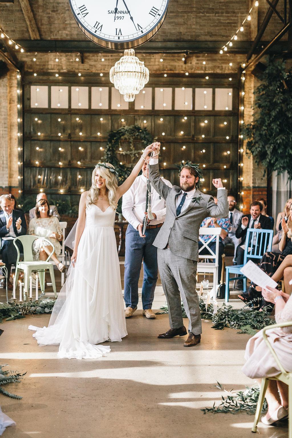shannon-britt-mackensey-alexander-photography-green-wedding-shoes-ivory-and-beau-bridal-boutique-savannah-wedding-planner-savannah-bridal-boutique-savannah-wedding-dresses-savannah-florist-summer-solstice-wedding-boho-soho-south-cafe-wedding-55.jpg