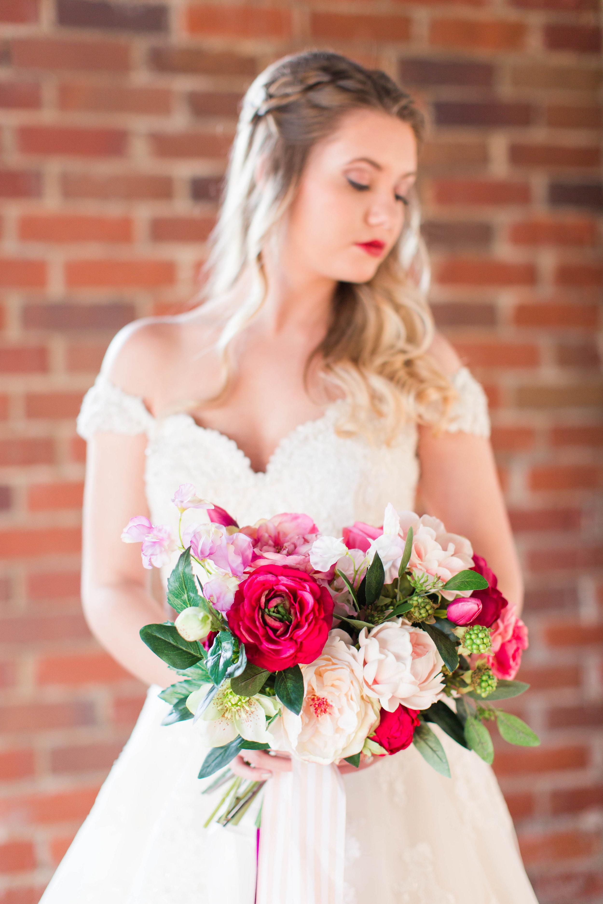 afloral-fake-flower-wedding-ivory-and-beau-bridal-boutique-maggie-sottero-saffron-the-hall-on-vine-wedding-statesboro-wedding-savannah-wedding-kristian-designs-rachel-strickland-photography-savannah-bridal-southern-bride-savannah-bride-1.jpg