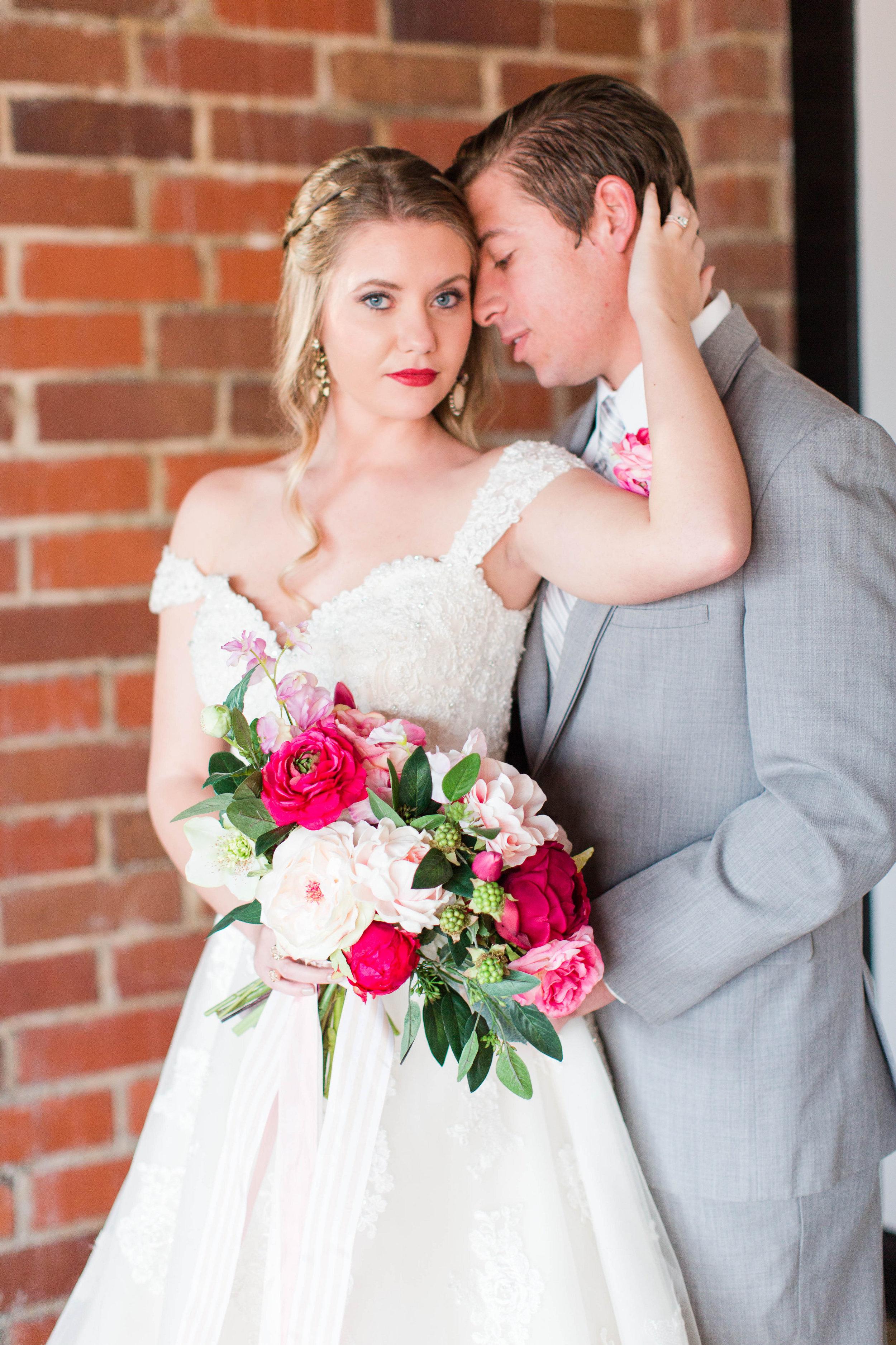 afloral-fake-flower-wedding-ivory-and-beau-bridal-boutique-maggie-sottero-saffron-the-hall-on-vine-wedding-statesboro-wedding-savannah-wedding-kristian-designs-rachel-strickland-photography-savannah-bridal-southern-bride-savannah-bride-13.jpg
