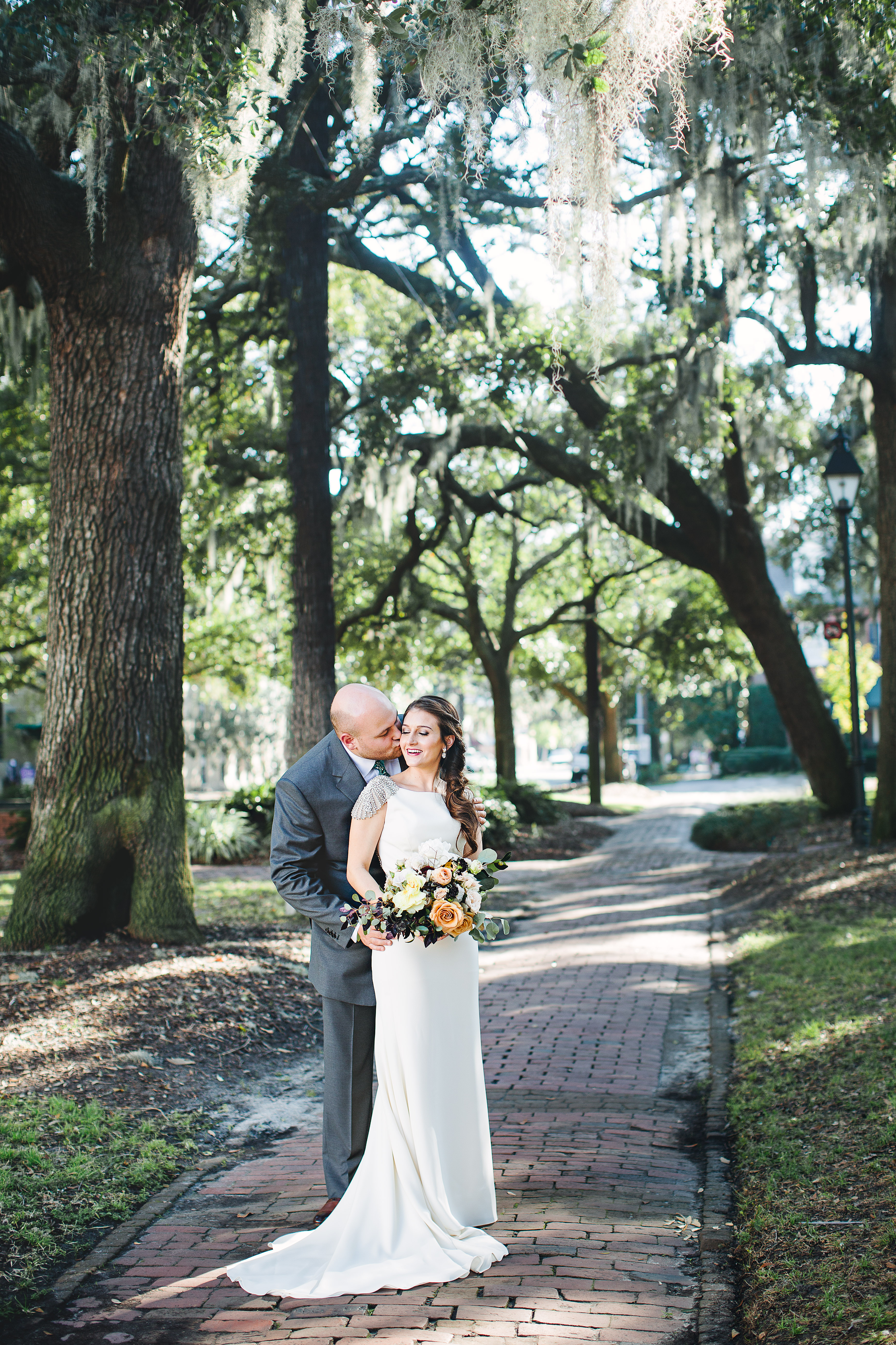izzy-hudgins-photography-savannah-wedding-ivory-and-beau-bridal-boutique-savannah-wedding-planner-colonial-house-of-flowers-forsyth-park-wedding-old-fort-jackson-wedding-squidwed-films-savannah-boutique-savannah-weddings-18.jpg