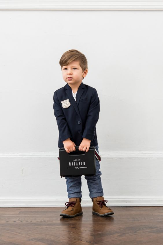Photo via Wedding Star [I couldn't find a picture of a ringbearer doing this... so just imagine his super cool briefcase is actually a really sweet picture of your lost loved one!!]