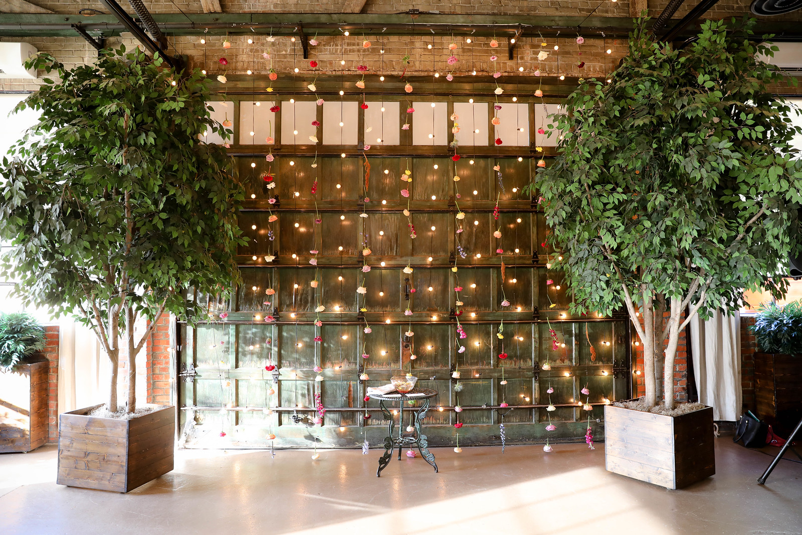 Isn't this floral wall mixed with string lights so stunning? We loved getting to create this stand-out piece!