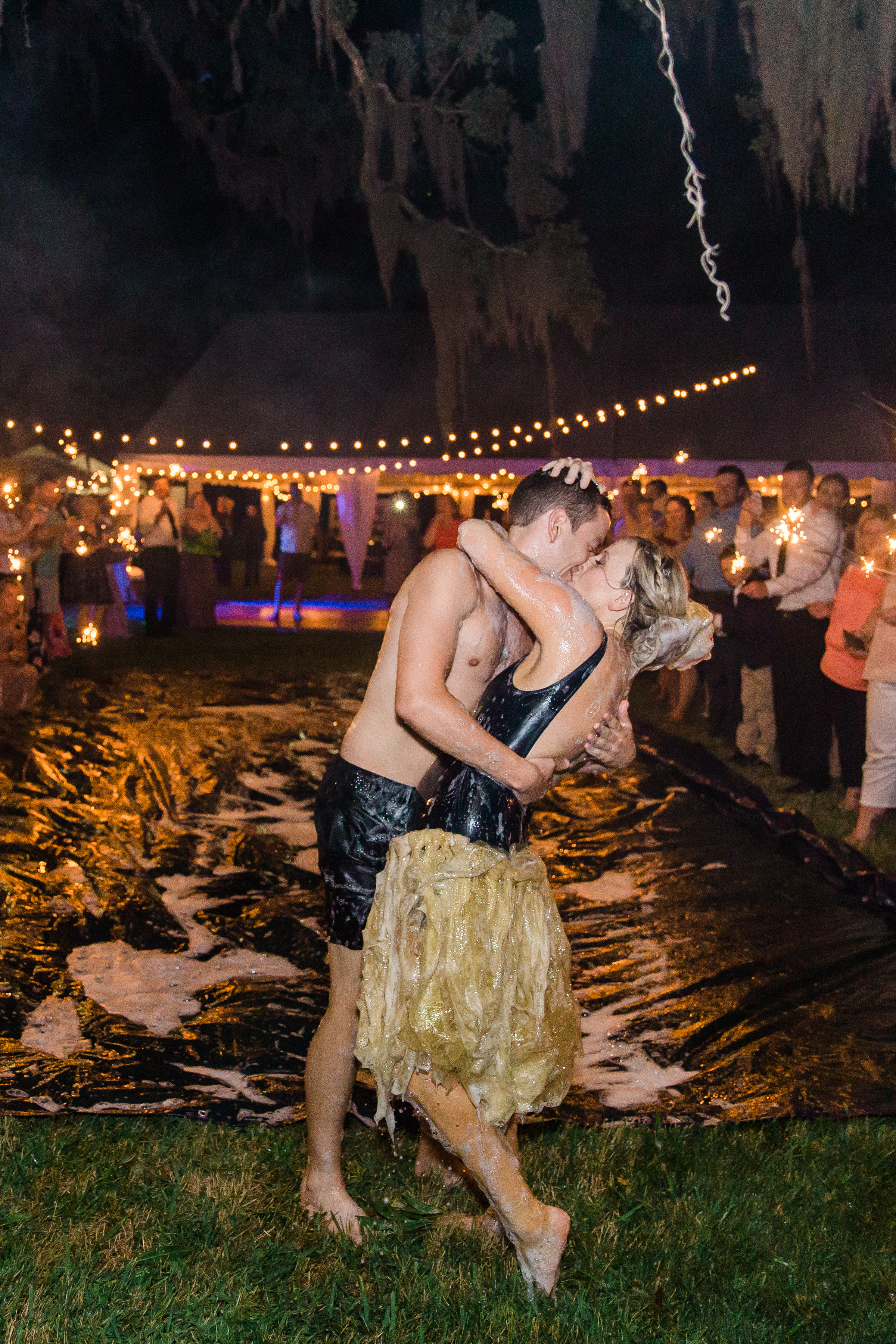 And to make this day even better? They ended their reception with a slip-and-slide!! How freaking cool is that?!