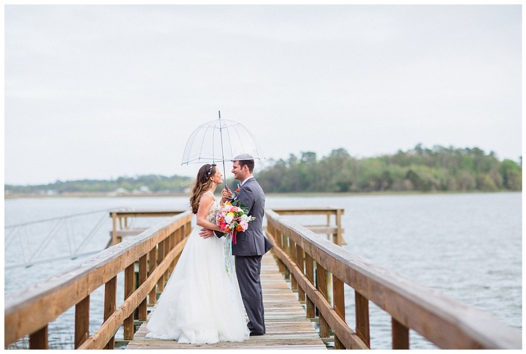 savannah-wedding-savannah-georgia-wedding-wedding-photo-ideas-rainy-wedding-day-umbrella-wedding-savannah-florist-savannah-flowers-dock-photos-wedding-day-maggie-sottero-wedding-dress-wedding-gown-happy-couple-grey-suit-gray-suit.jpg