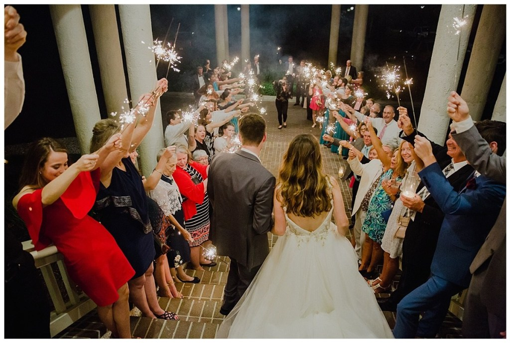 wedding-exit-grand-exit-sparklers-at-wedding-leaving-the-reception-maggie-sottero-wedding-dress-maggie-sottero-wedding-gown-low-back-dress-savannah-wedding-planning-savannah-georgia-wedding-savannah-bride-wedding-reception-wedding-exit.jpg