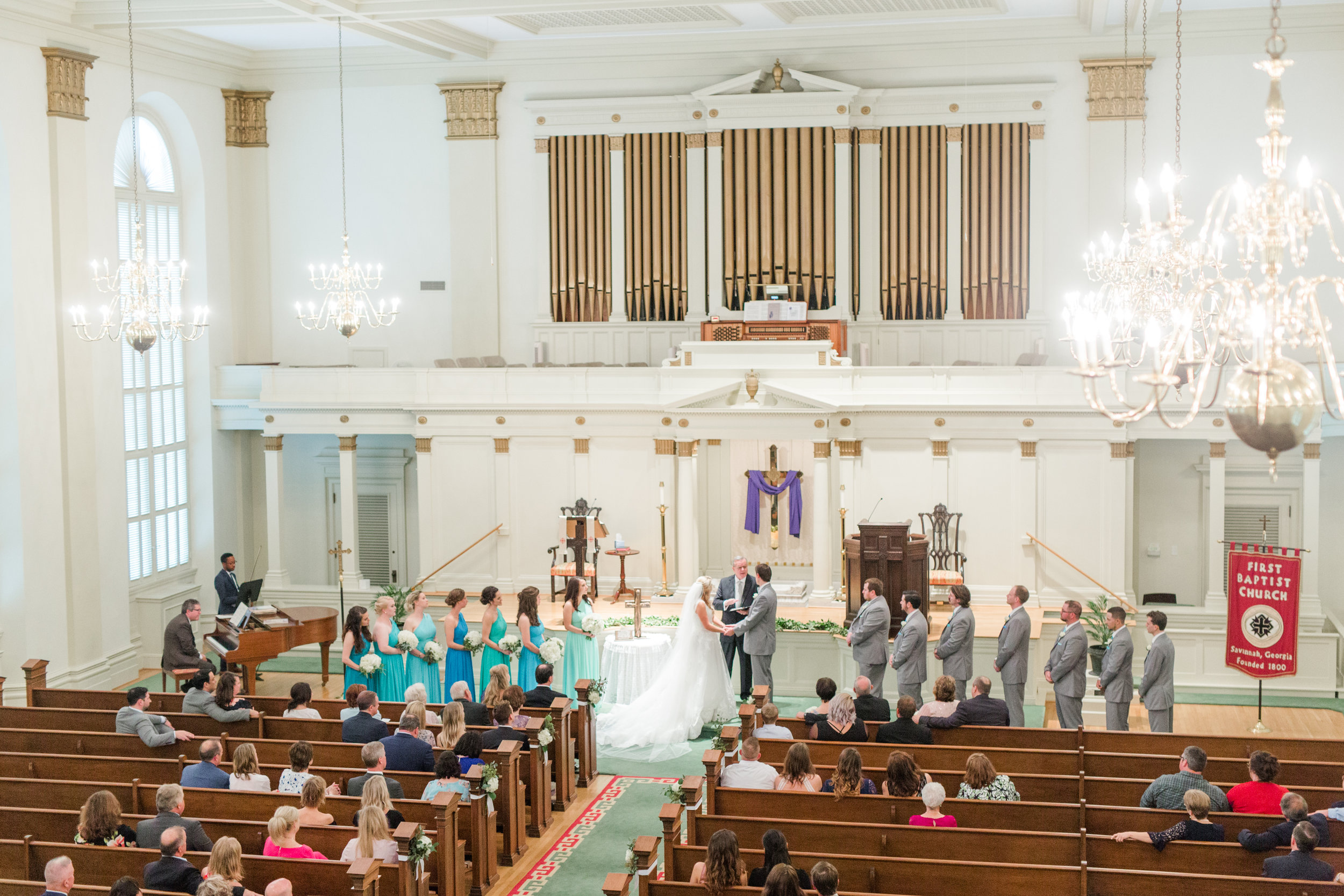 Their chapel wedding was so beautiful! We love how the teal pops so much even from so far away… And that train?! INSANE!