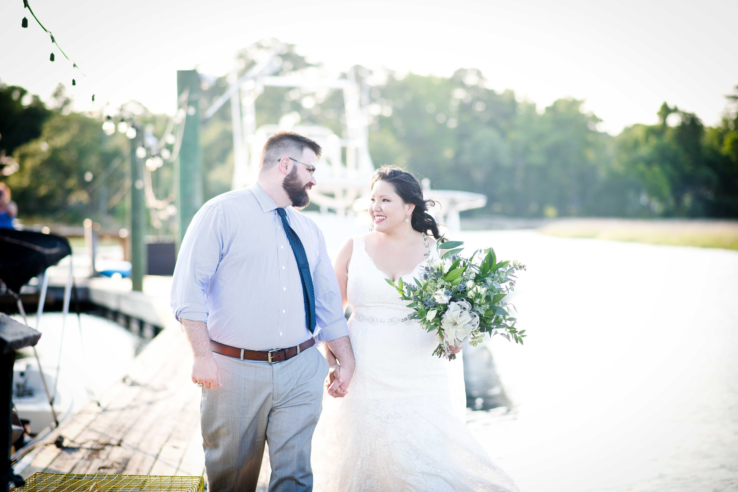 Tina-and-Javin-Bride-And-Groom-Savannah-Weddings-Dockside-Weddings-Savannah-Weddings-Savannah-Florist-The-Wyld-Venue-Lowcountry-Weddings-Natural-Weddings-Southern-Weddings-Couple-Wedding-Photos-Greenery-Bouquets-Natural-Color-Scheme.jpg