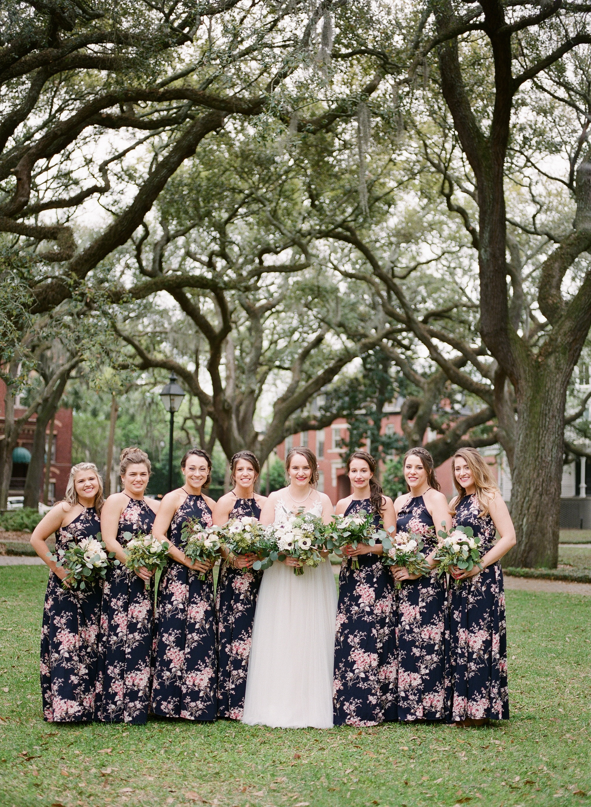 Use that back drop! The massive trees make for a dramatic photo that you will swoon over!