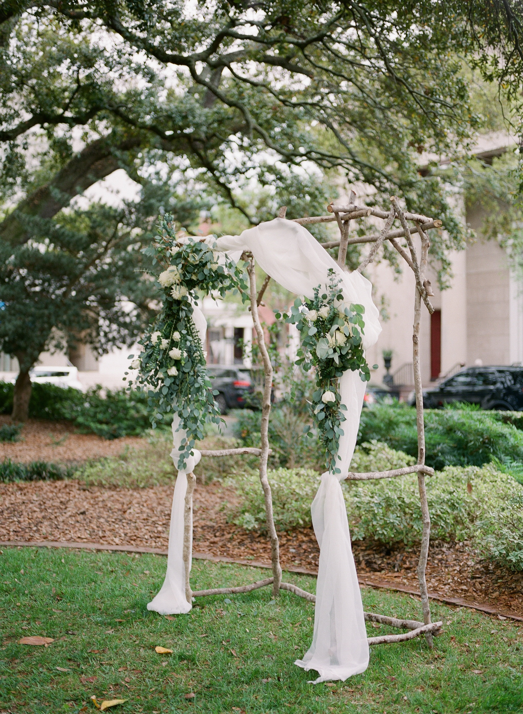 Simplicity can be key when getting married in already beautiful on its own space. Have a small, flower covered alter in the middle of the lush green of the square Also, as you can tell, the pop of color of the blooms against all of the green makes for some amazing photos!