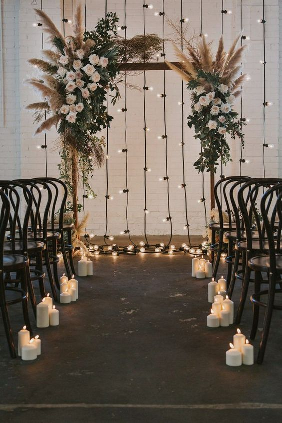 This boho-chiq altar is perfect for an indoor venue with exposed brick and of course of the more laid-back boho elegant bride. We are pricing this bad boy at $1,500 as Ivory & Beau already as the wooden base!