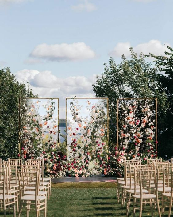 The tri-fold altar equipped with loose blooms and greenery is undeniably epic, perfect for a venue that is a little less busy! We are pricing this piece at $6,000.00 with panel design, florals, greenery and set-up!