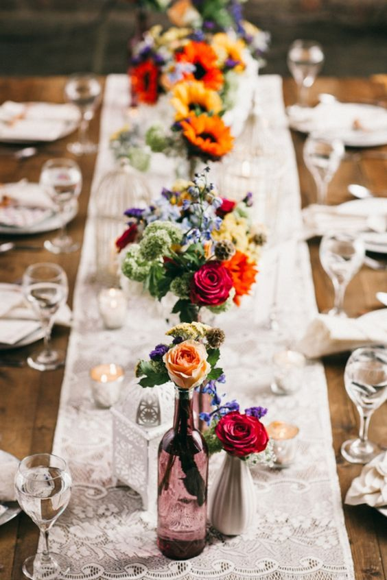 We have done SO many beautiful weddings with centerpieces complete with just a few mismatched bud vases and blooms. This style gives a revamp to the classic rustic style.
