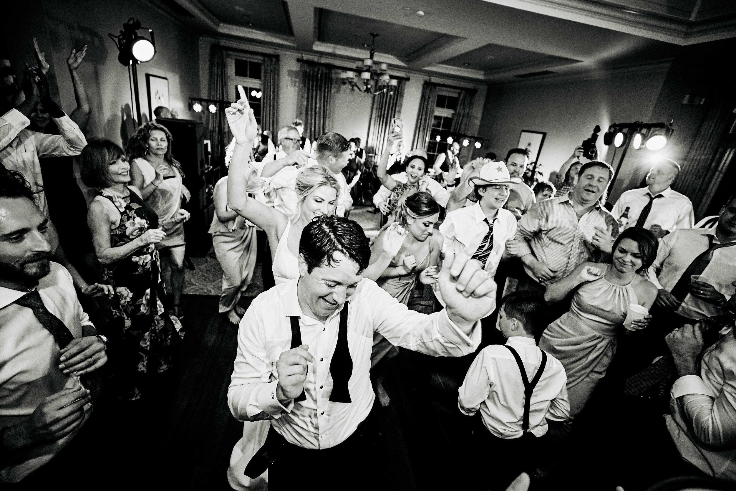 annie-and-greg-reception-savannah-georgia-belfair-plantation-party-fun-savannah-wedding-coordinator-family-and-friends-dancing-singing-band.jpg
