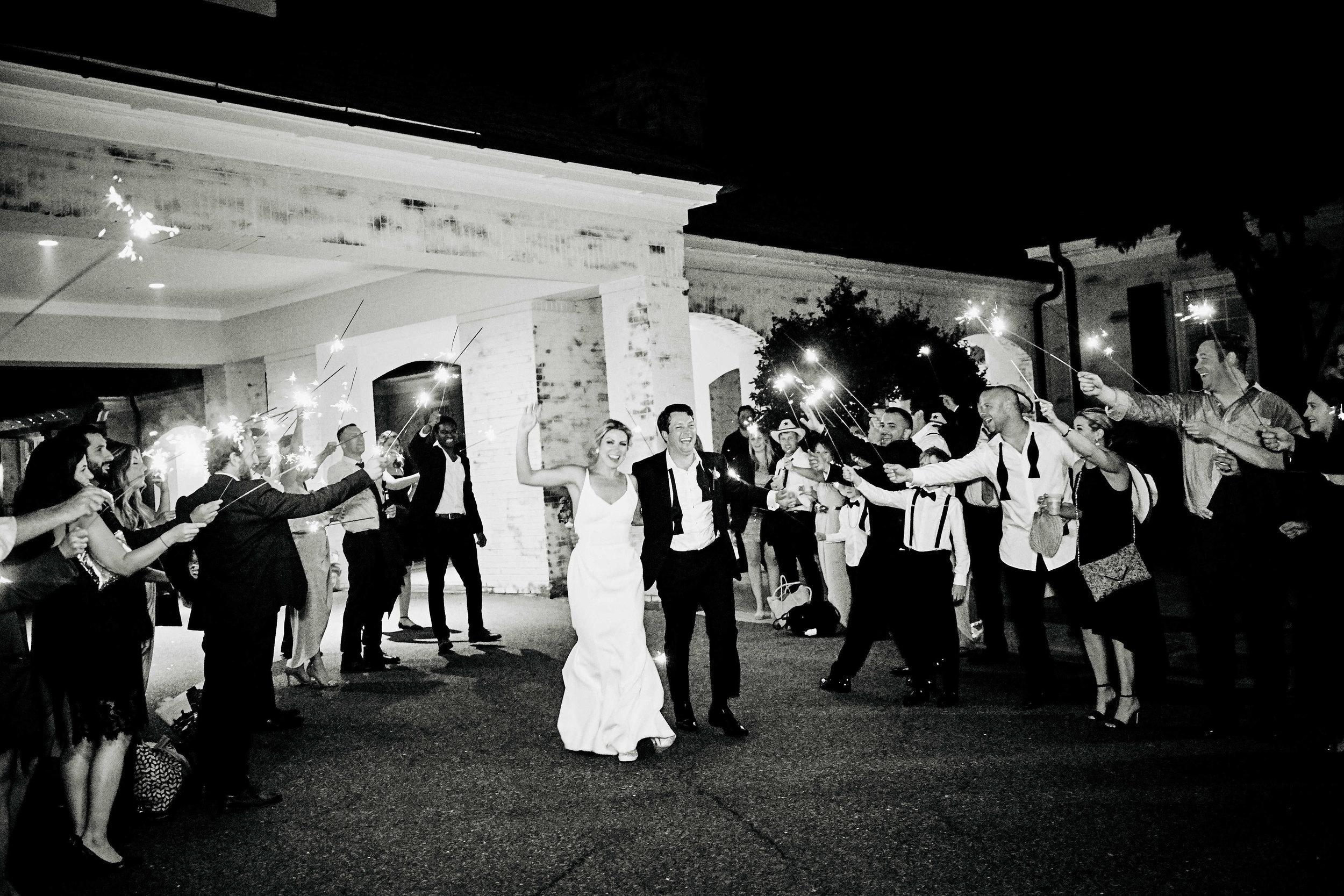 annie-and-greg-savannah-wedding-coordinator-belfair-plantation-georgia-grand-exit-sparklers-ivory-and-beau-reception.jpg