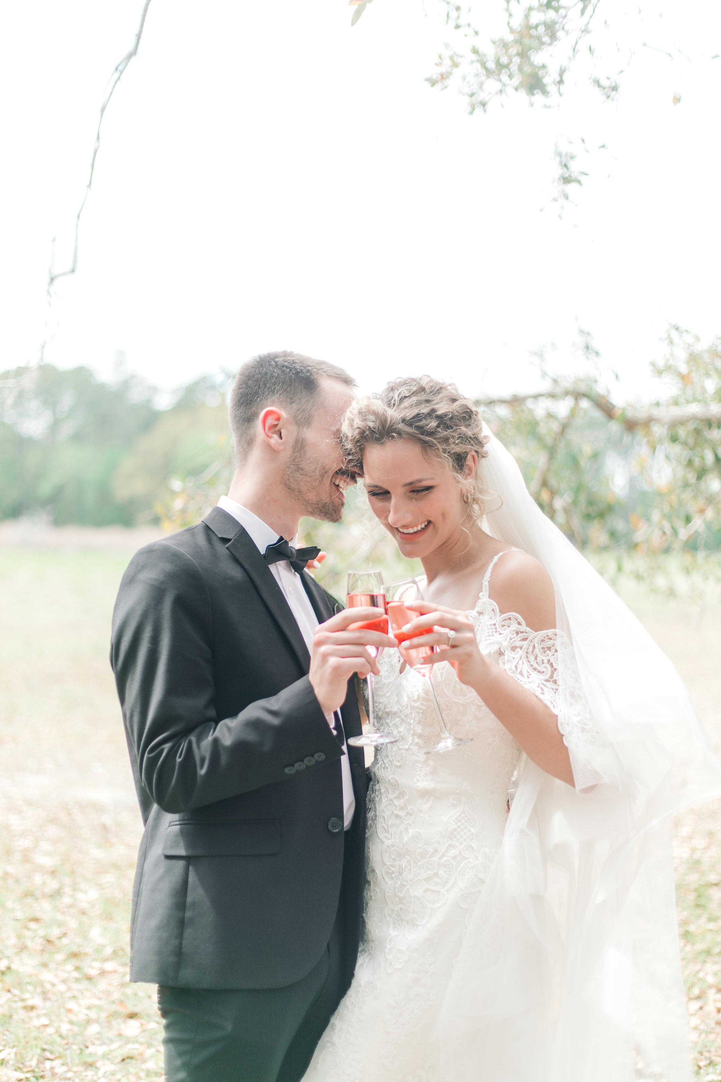 champagne-toast-wormsloe-historic-park-elopements-wormsloe-weddings-savannah-wedding-dresses-maggie-sottero-elliana-off-the-shoulder-wedding-dress.jpg
