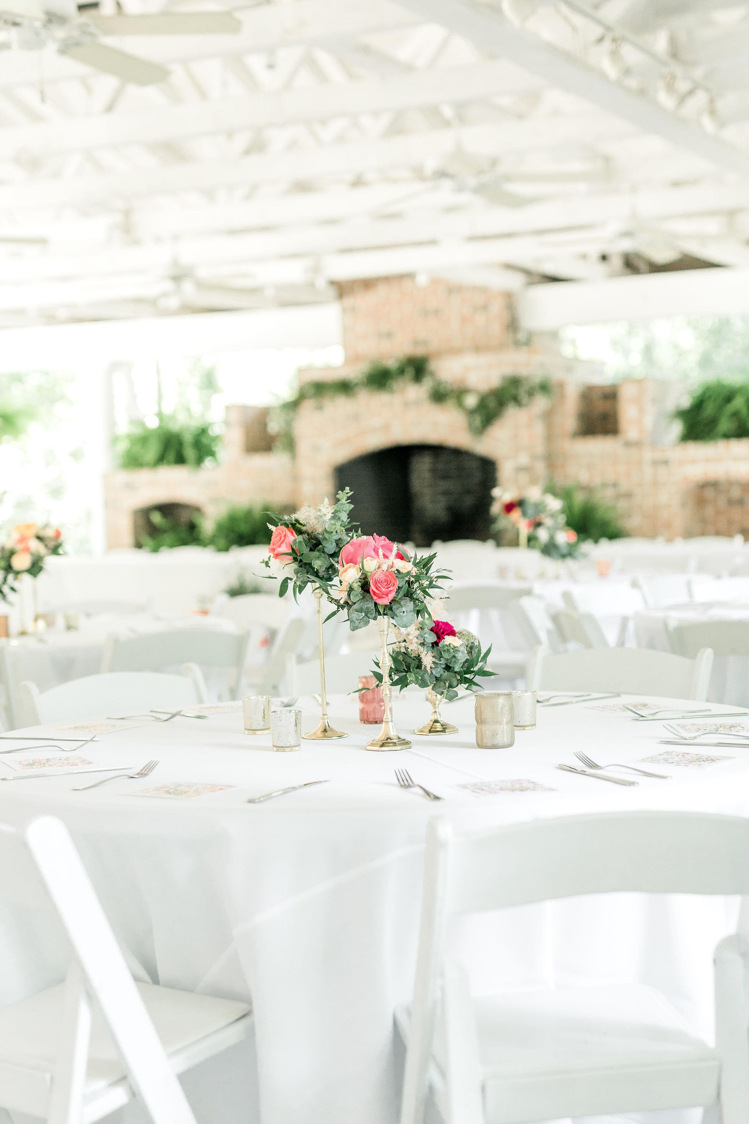 candlestick-centerpiece-hot-pink-flowers-boho-center-piece-tall-centerpieces-savannah-wedding-candle-centerpiece-white-and-hot-pink-centerpice-mackey-hosue-wedding-greenery-and-cloral-flowers.jpg