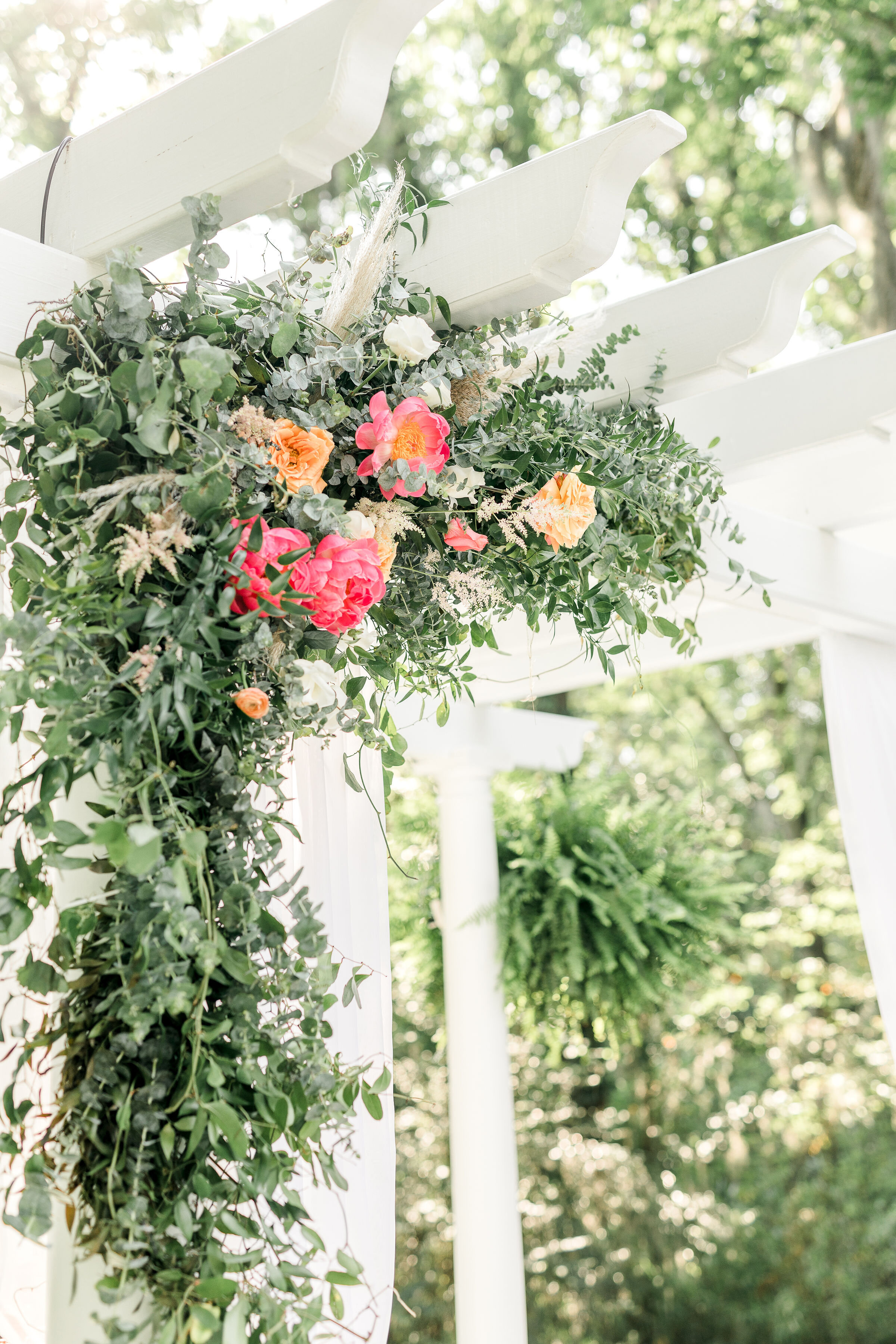 hanging-flower-design-pink-and-green-flowers-ceremony-backdrop-flowers-greenery-southern-wedding.jpg