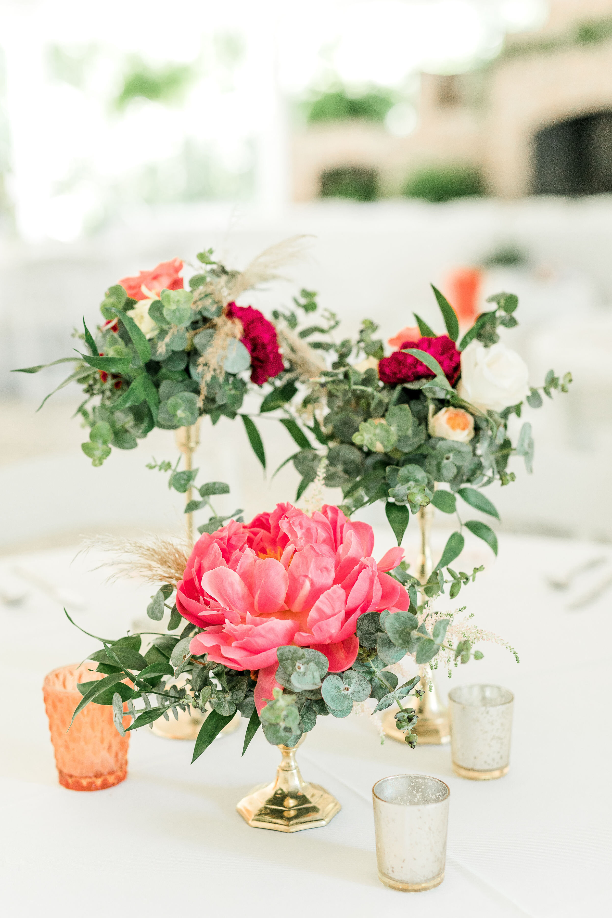 floral-center-pieces-candlestick-center-piece-pink-green-flowers-candle-centerpiece-bright-colors-colorful-wedding-savannah-wedding-mackey-house-wedding.jpg