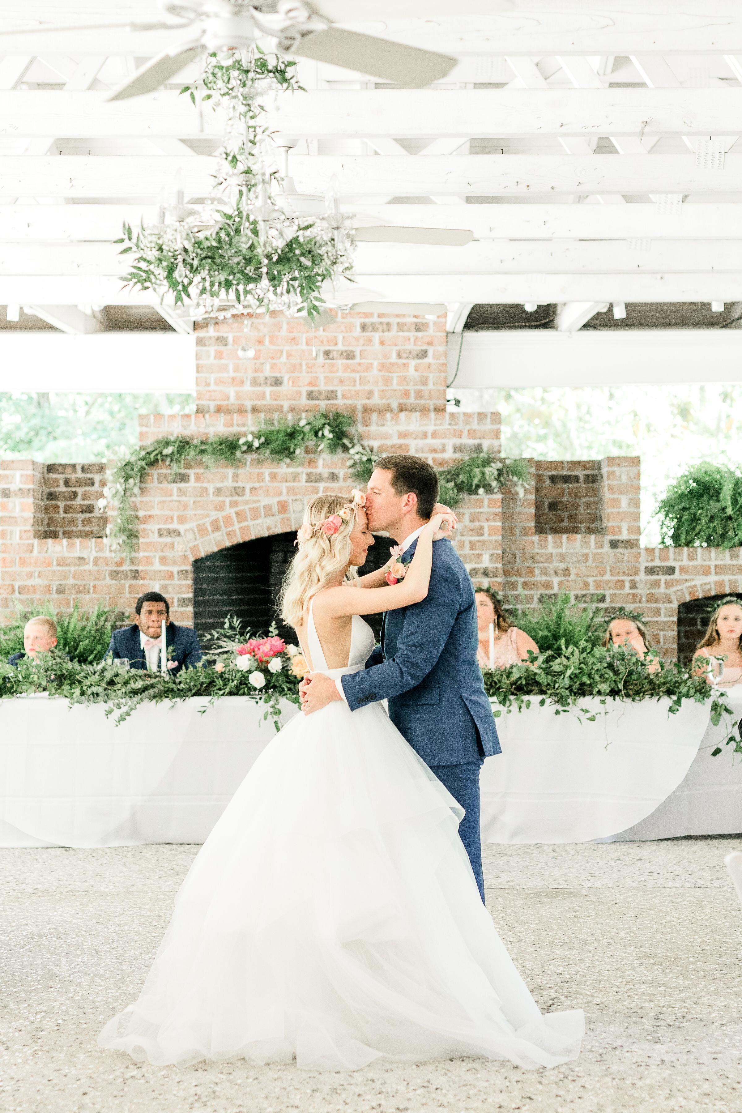 first-dance-wedding-savannah-wedding-pink-flowers-pink-and-green-southern-couple-mackey-house-greenery.jpg