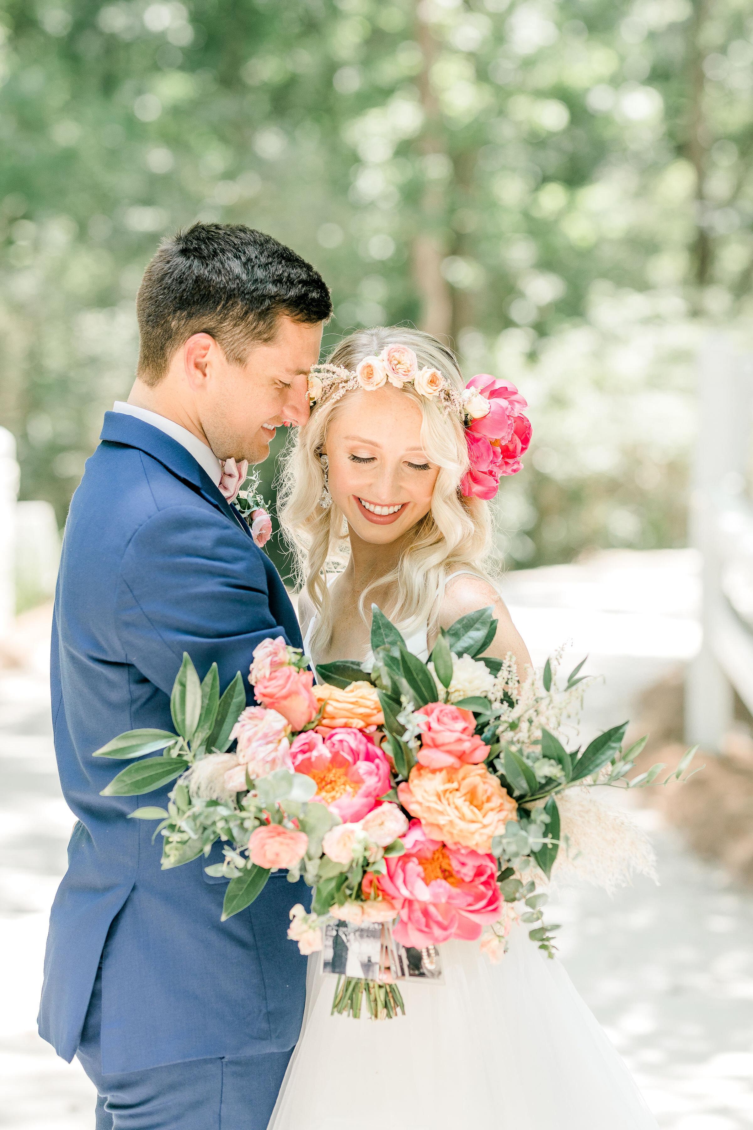 southern-couple-colorful-wedding-bright-flowers-pink-flowers-pink-and-green-flowers-flower-crown-mackey-house-wedding-couple.jpg