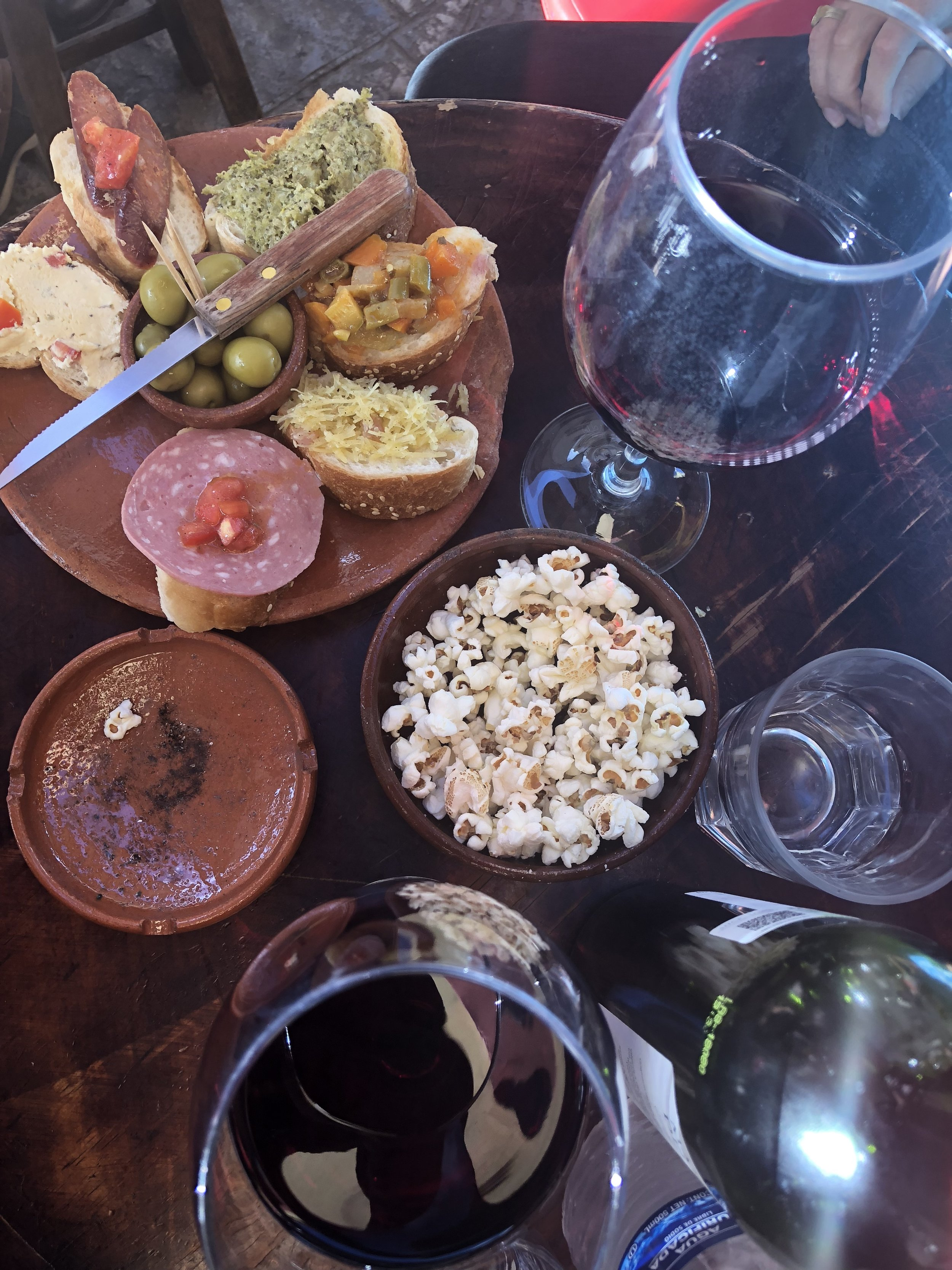 Order a bottle of wine, get a plate of free tapas.