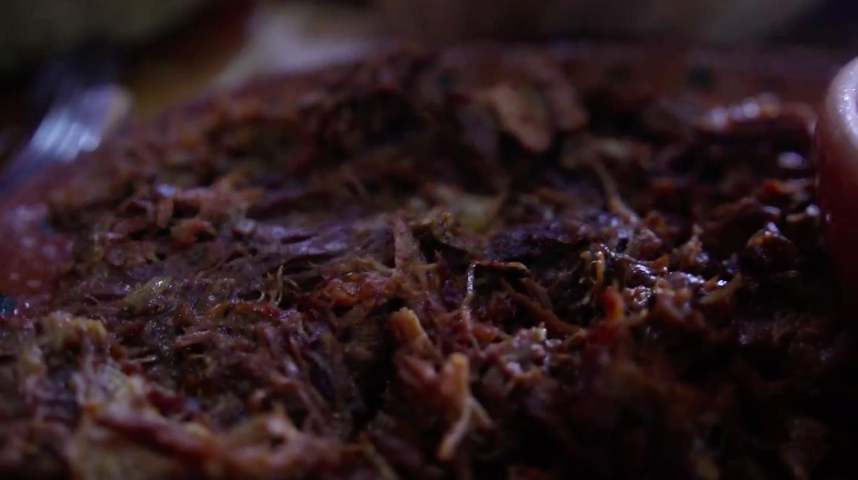 Borrego Tatemado — Fire-roasted lamb, a house specialty