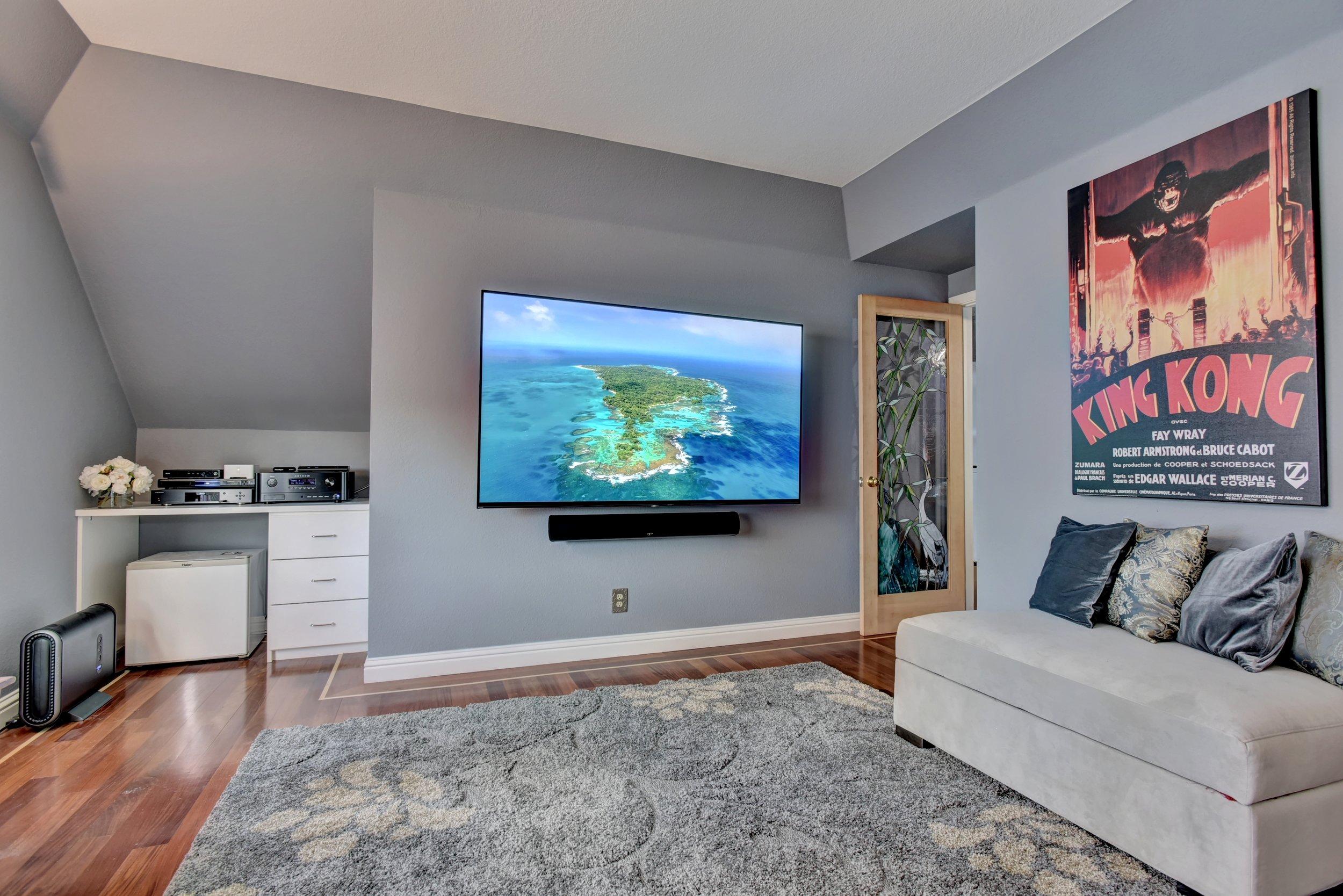 Sony 77-inch 4K UHD OLED TV with Anthem MRX 520 AV receiver and Paradigm Millenia 20 Trio Reference Soundbar