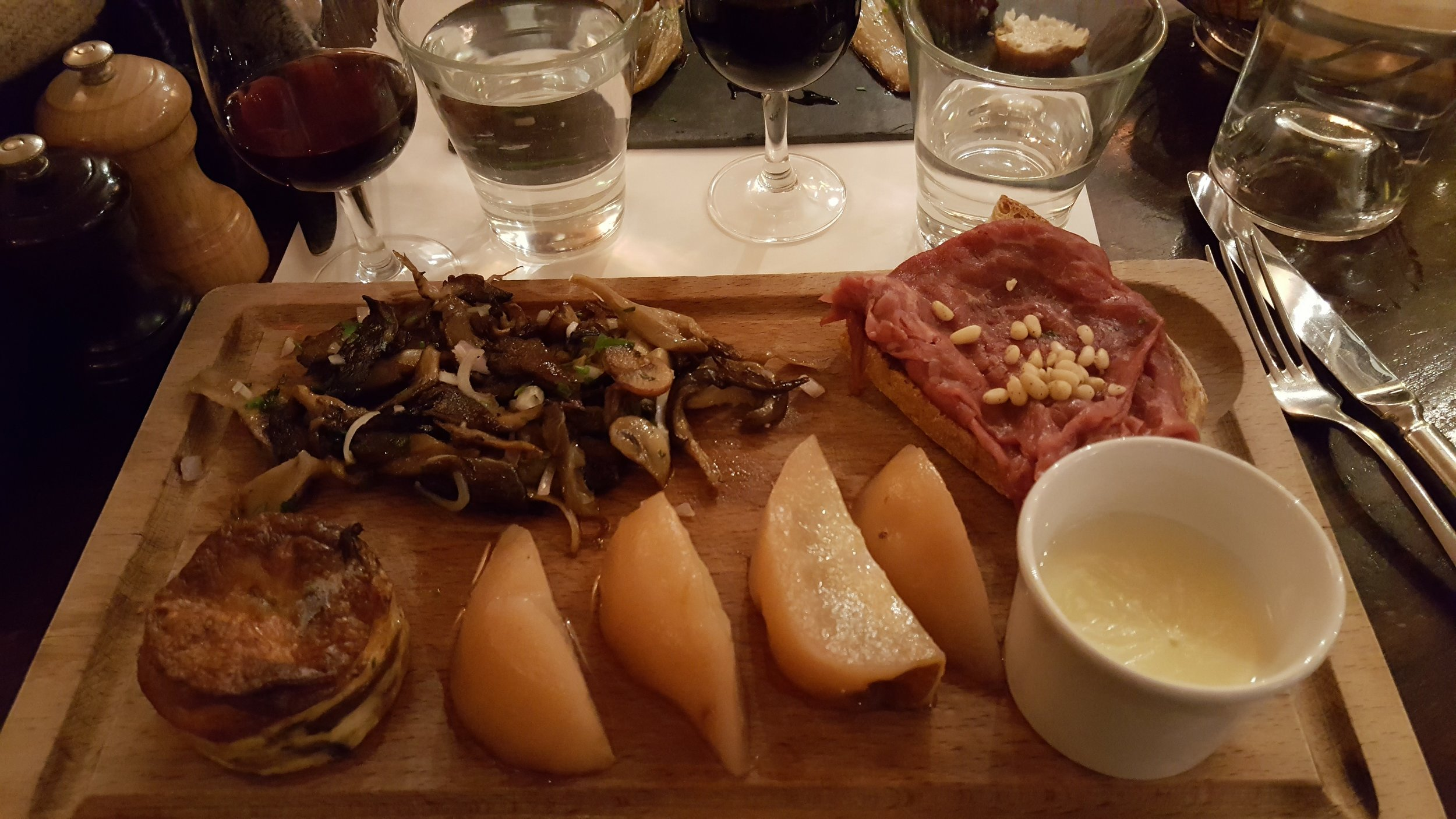 Meatboard with mushrooms and pears