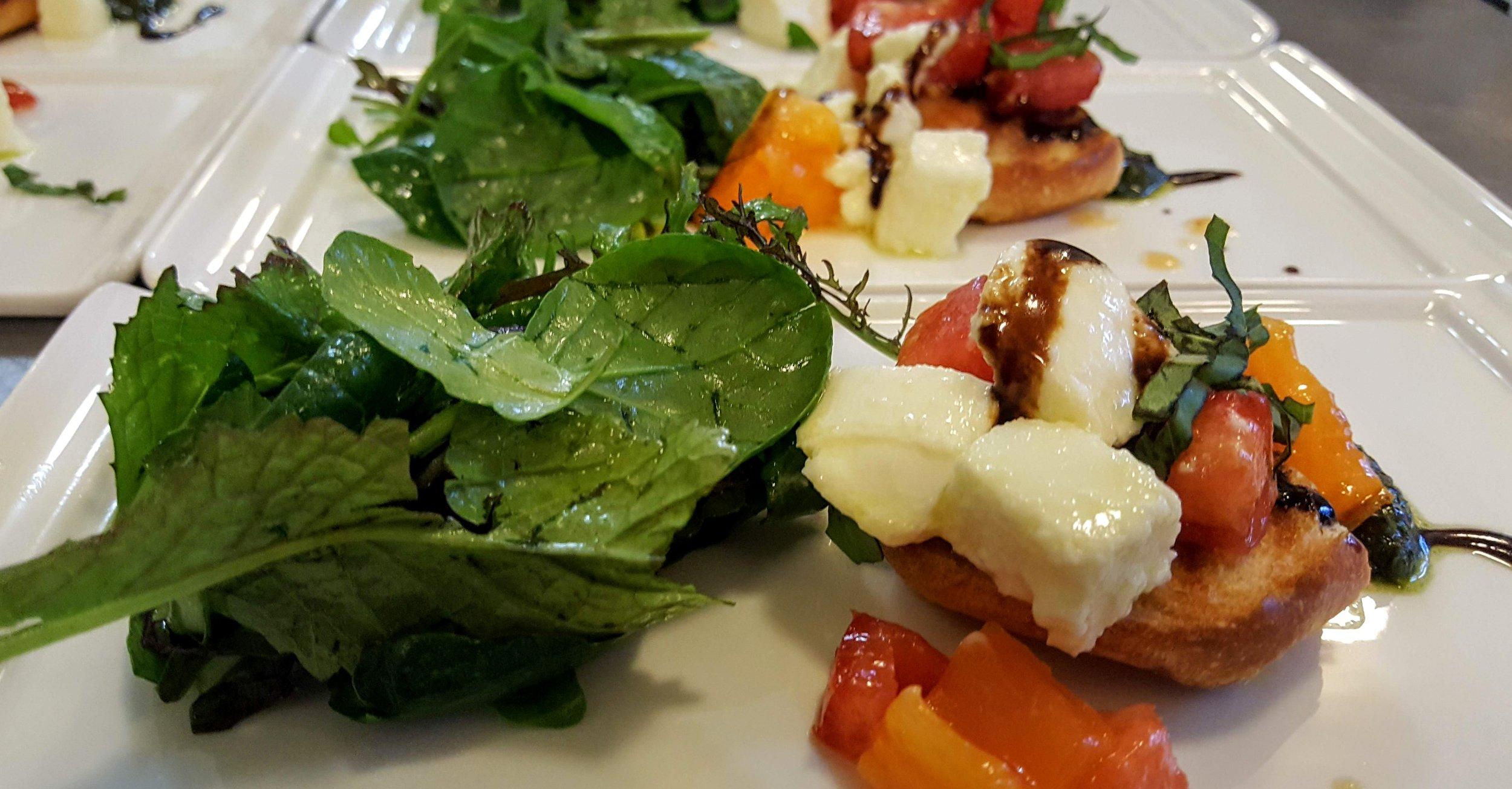 Caprese Salad  Mama Bird heirloom tomatoes, mixed greens, fresh mozzarella, grilled house baguette, balsamic reduction, pesto