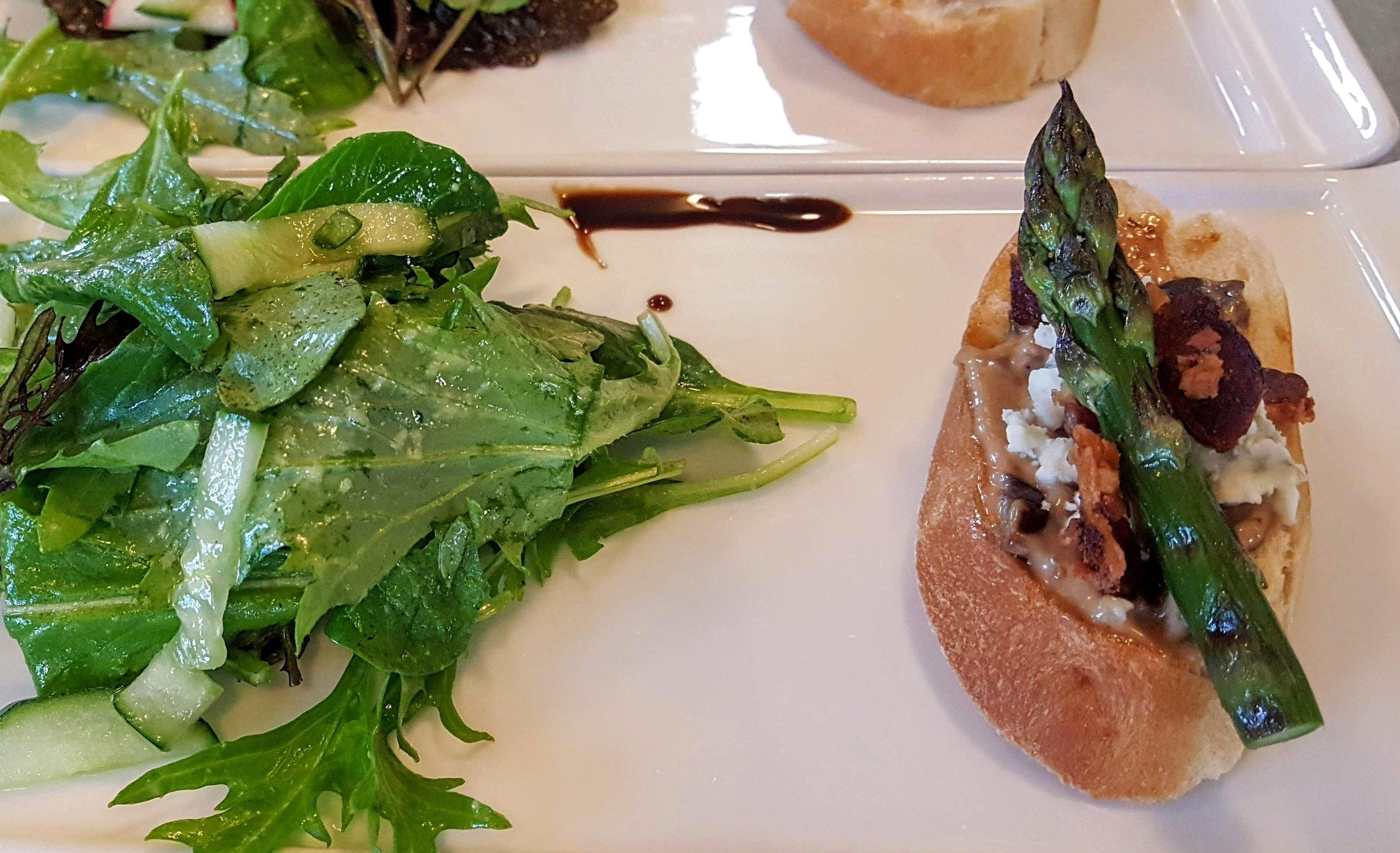 Smokey Blue & Bacon Bruschetta  Grilled asparagus, local mixed greens, cucumber & lemon vinaigrette
