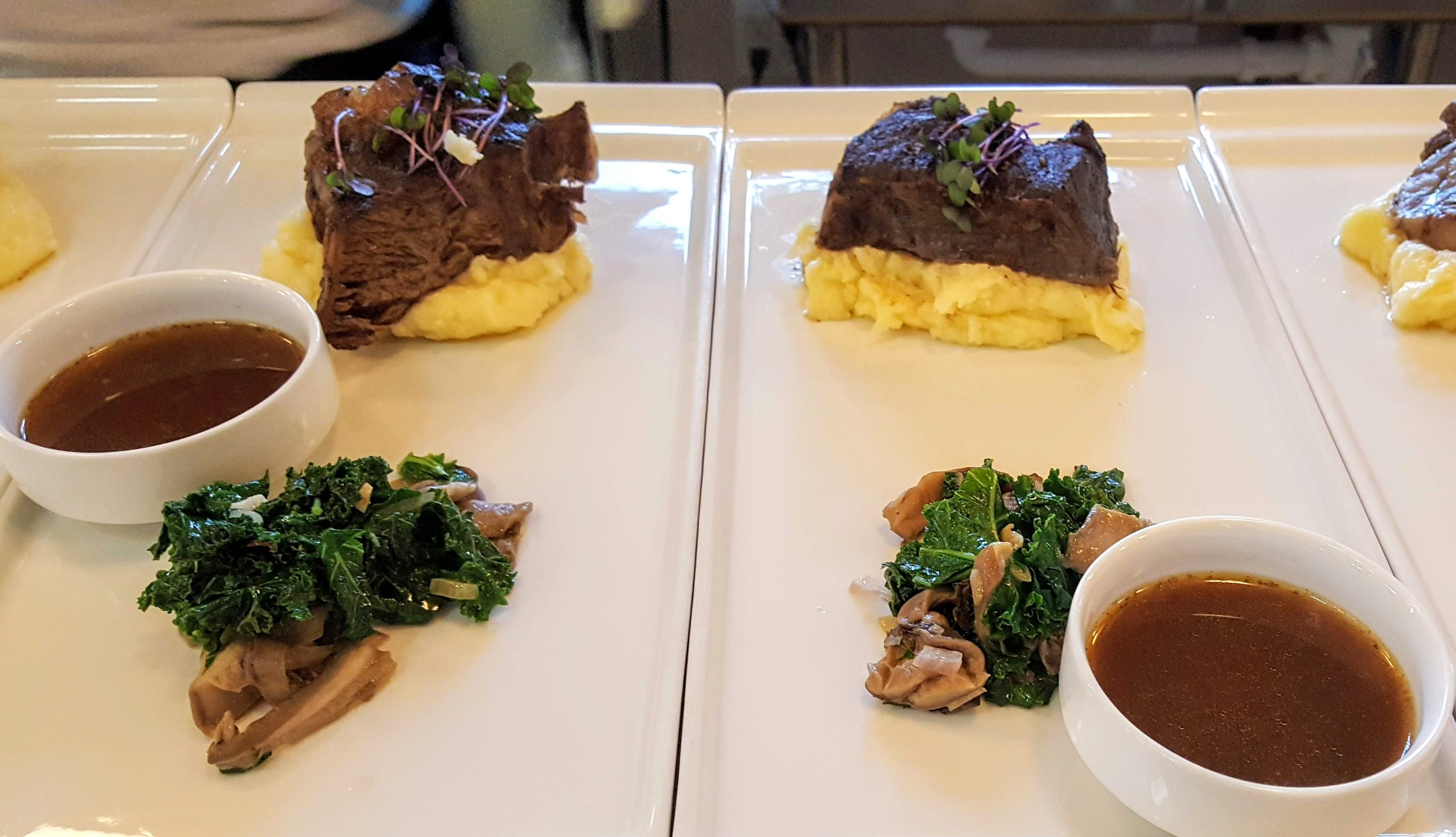 Red Wine Braised Short Ribs  Whipped yukon gold potatoes with chevre, blue oyster mushrooms, kale, braising jus
