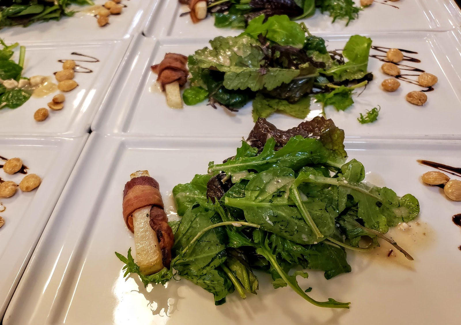 Mama Bird Mixed Green Salad  Blue Cheese Vinaigrette, Bacon Wrapped Roasted Turnips, Balsamic Reduction and Toasted Almonds