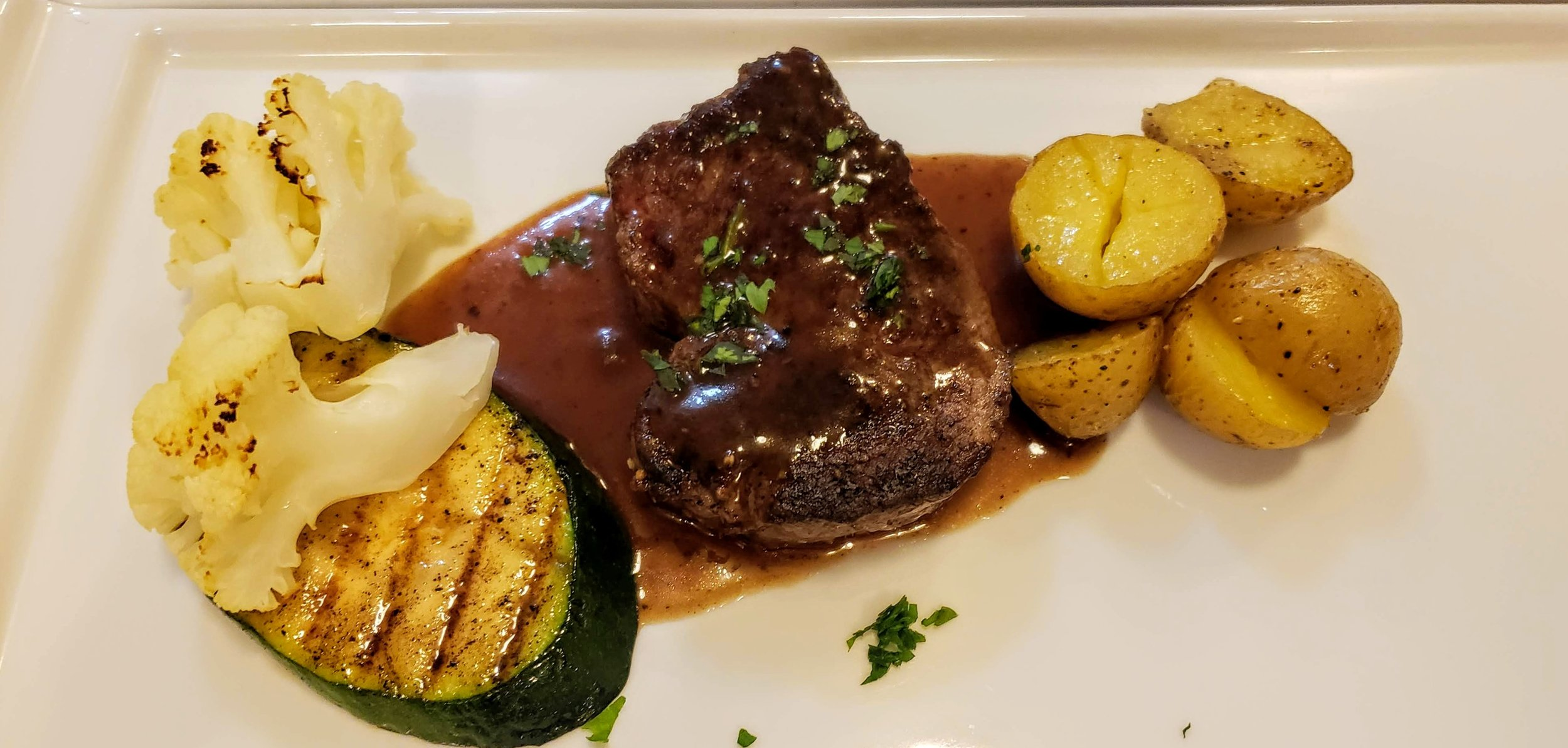 Pan Roasted Beef Tenderloin  Roasted Fingerling Potato, Seasonal Vegetables, Red Wine Demi