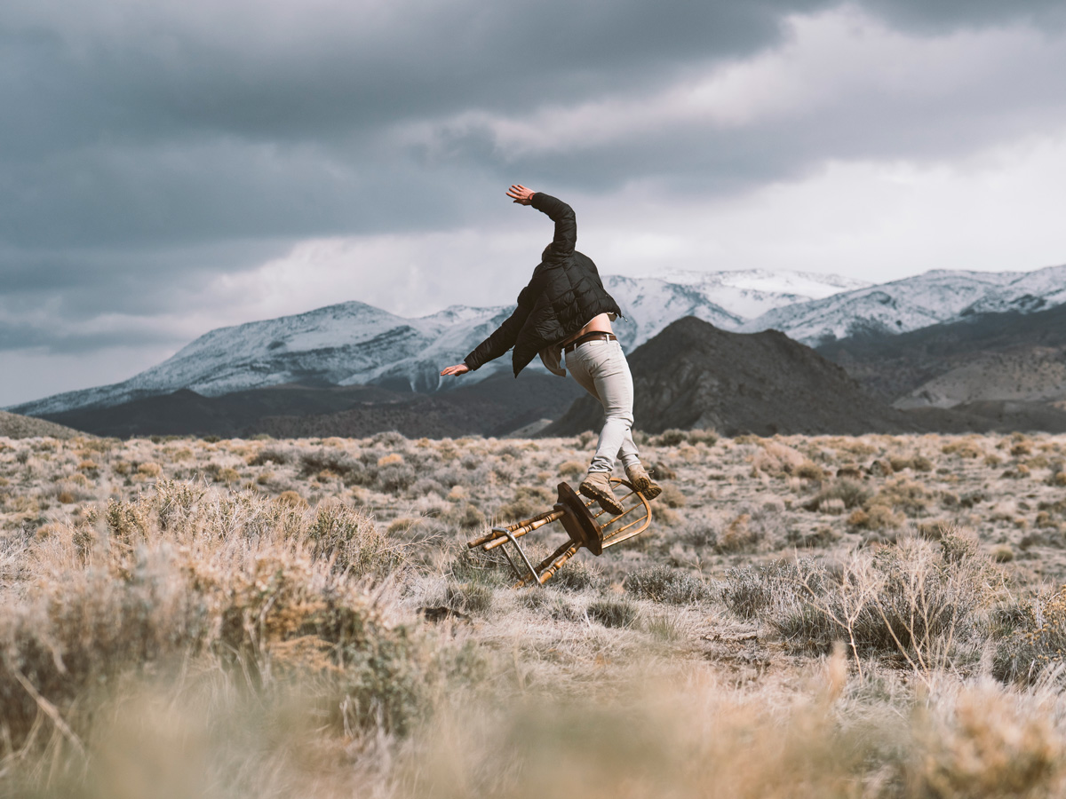 Man falling off of a chair in the wilderness.jpg