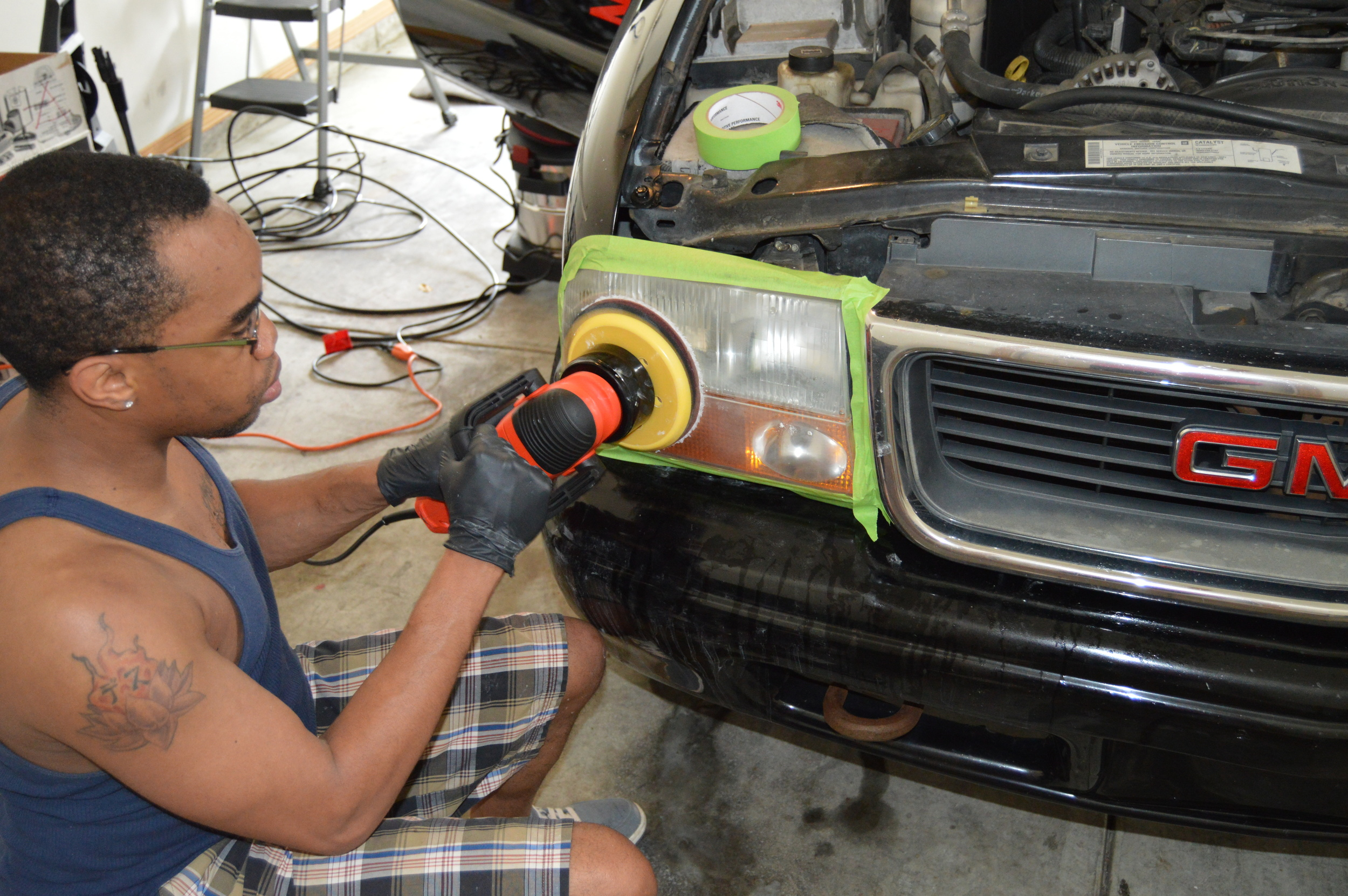 After sanding off headlight oxidation headlights are polished to a like new state.