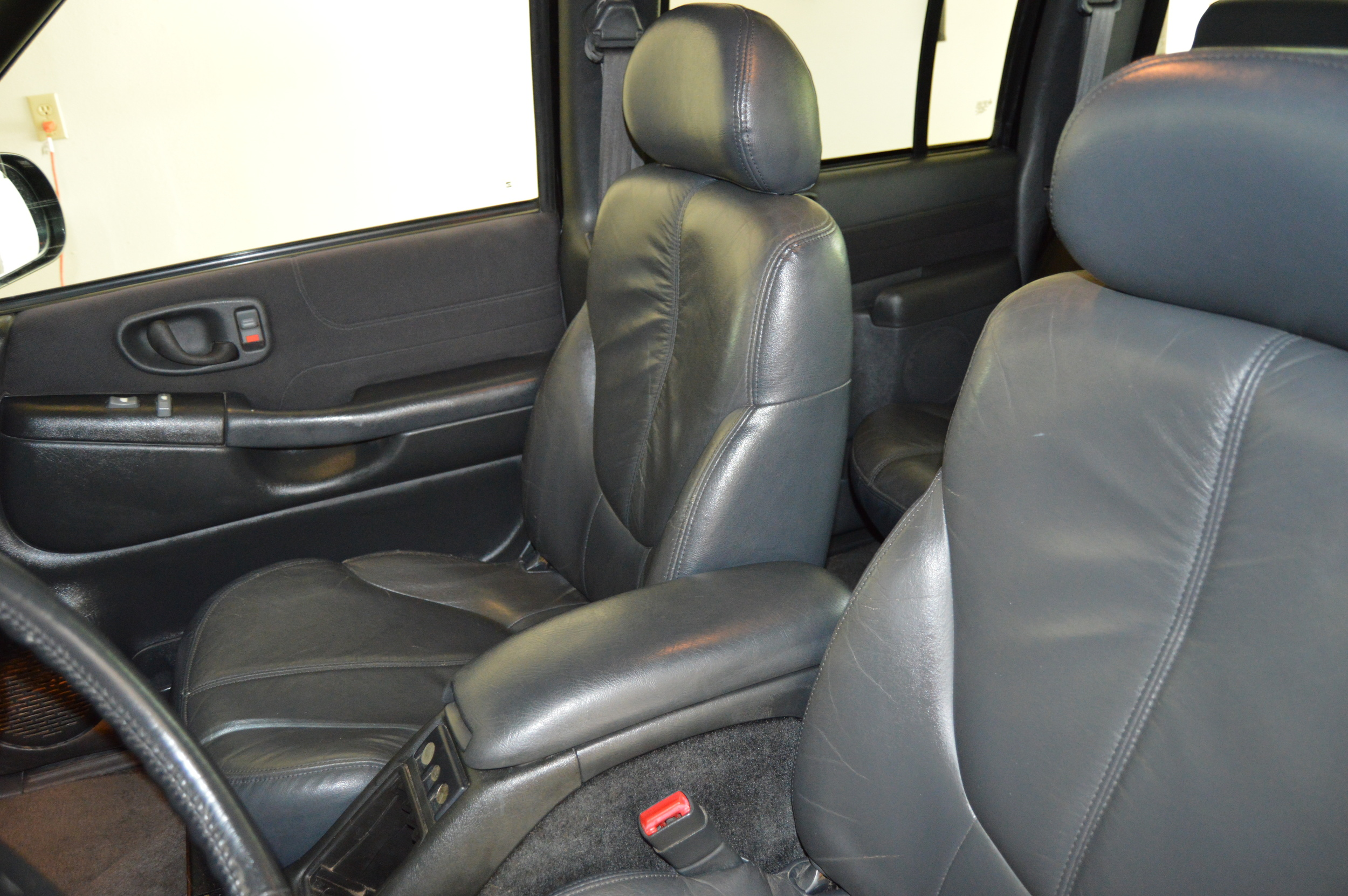 Leather seats shampooed and conditioned