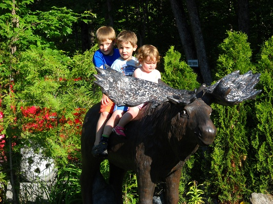 three-kids-posing-for-a-photo-on-the-moose.JPG