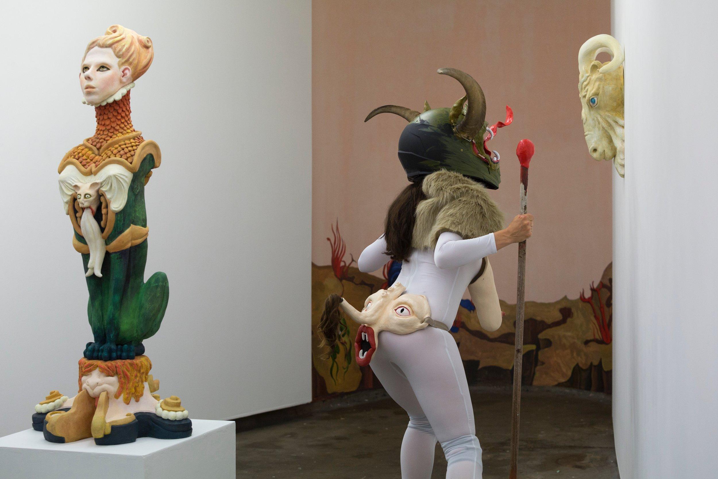 She Devil performed by Legs 11 11, hand built ceramic ,remodelled bike helmet, bull horns,polymer clay, oil paint, fake fur, remodelled stilettos,2017