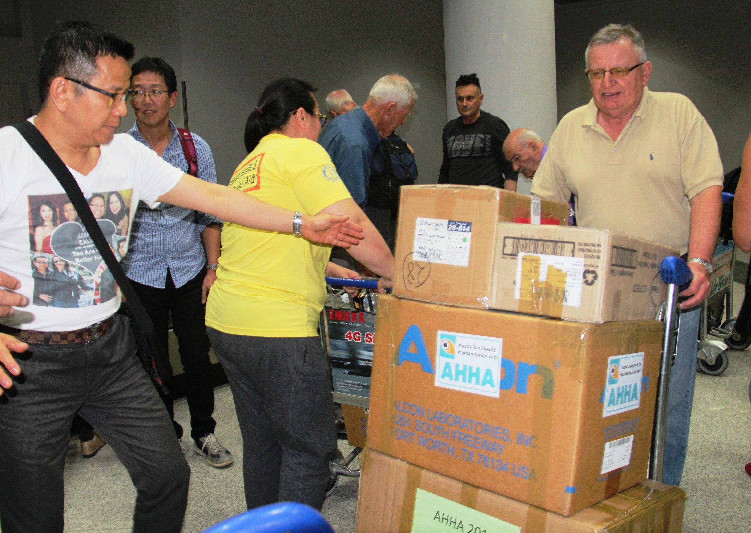 Volunteers unloading boxes at Phnom Penh airport